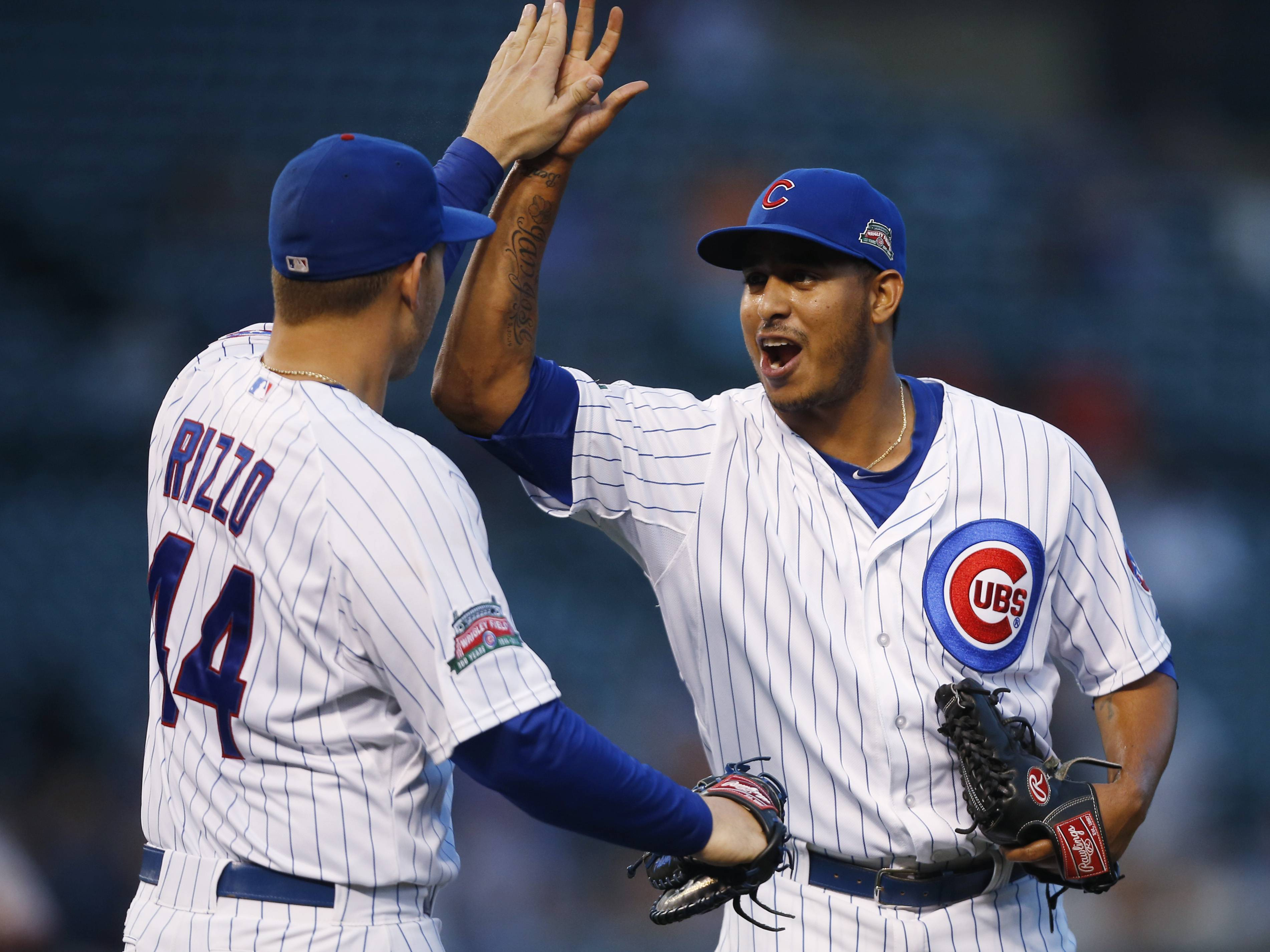 Cubs first baseman Anthony Rizzo and relief pitcher Hector Rondon celebrate after defeating the Giants in a continuation of a rain-suspended baseball game that began Tuesday and ended Thursday.