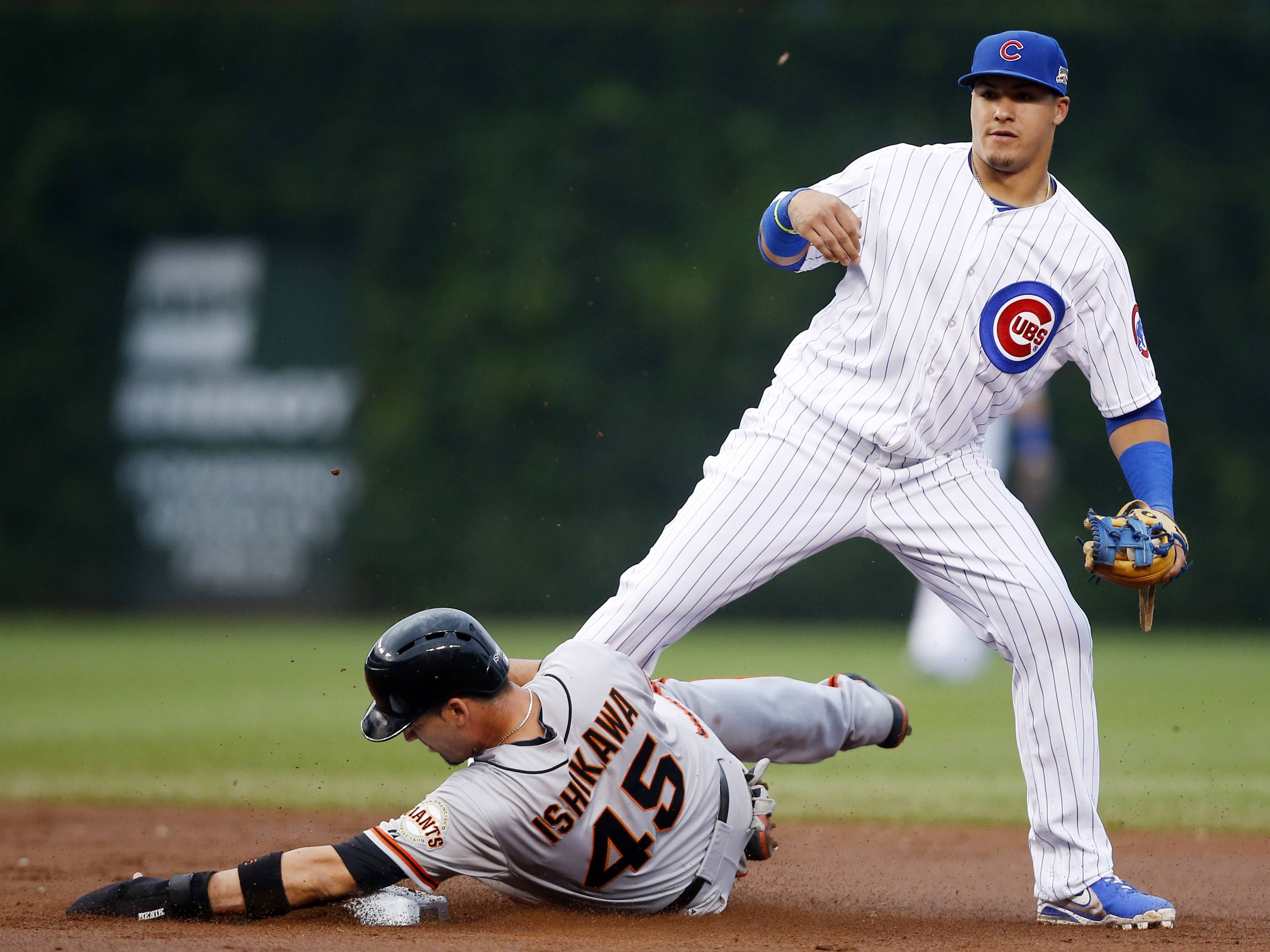 Cubs prevail in suspended game