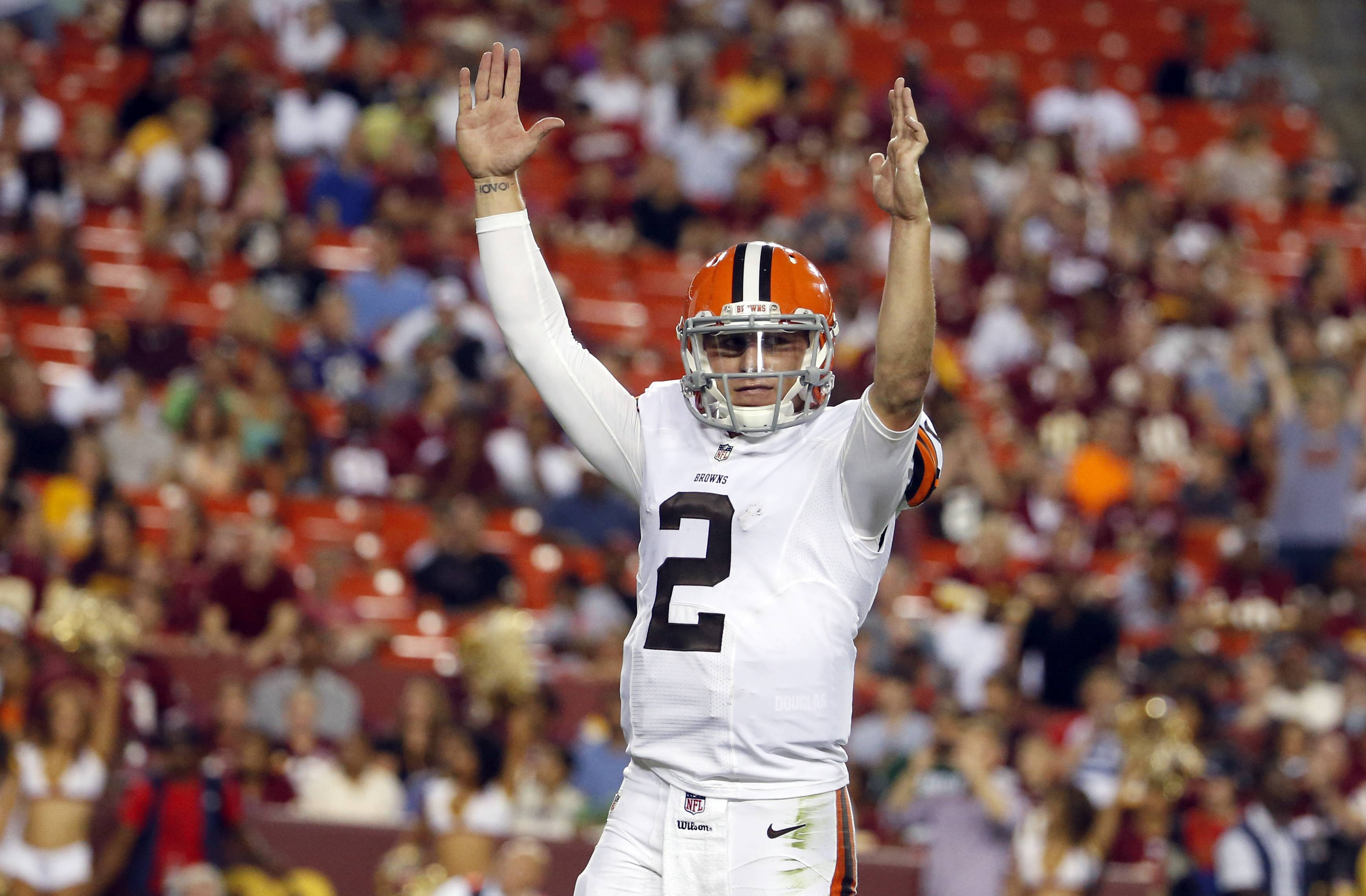 Cleveland Browns quarterback Johnny Manziel (2) celebrates running back Dion Lewis (28) scoring a touchdown on a pass, during the second half of an NFL preseason football game against the Washington Redskins Monday, Aug. 18, 2014, in Landover, Md.