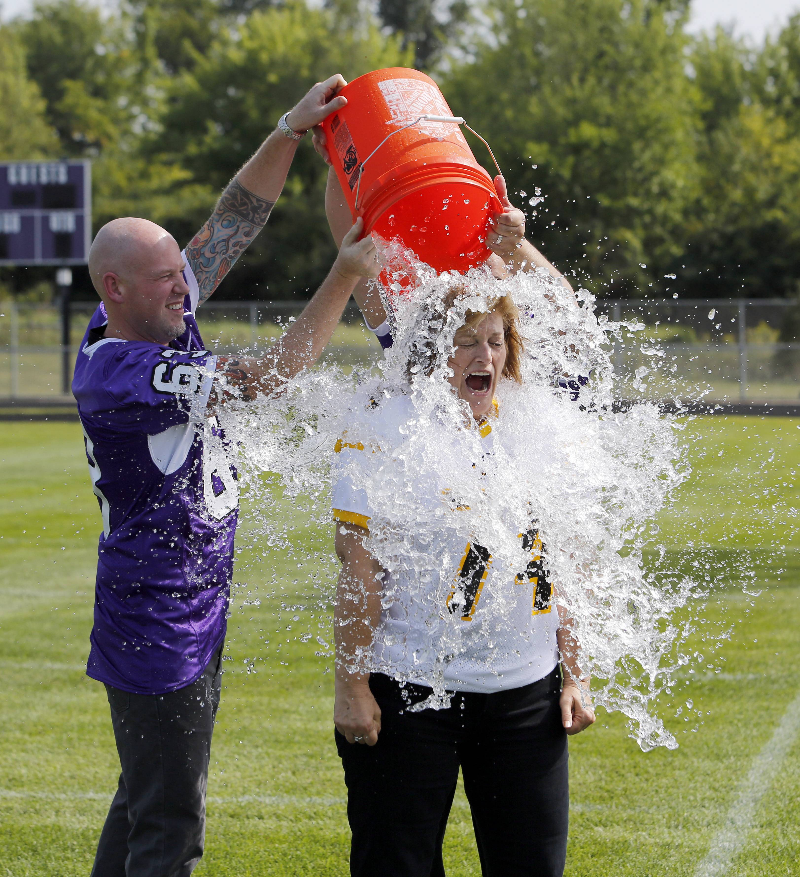 District 300 Associate Superintendent Sarah Kedroski is doused with a 5-gallon bucket of ice water by Ben Churchill, Assistant Superintendent for High School Teaching and Learning Superintendent's Cabinet, while taking the ALS ice bucket challenge Friday at Hampshire High School.