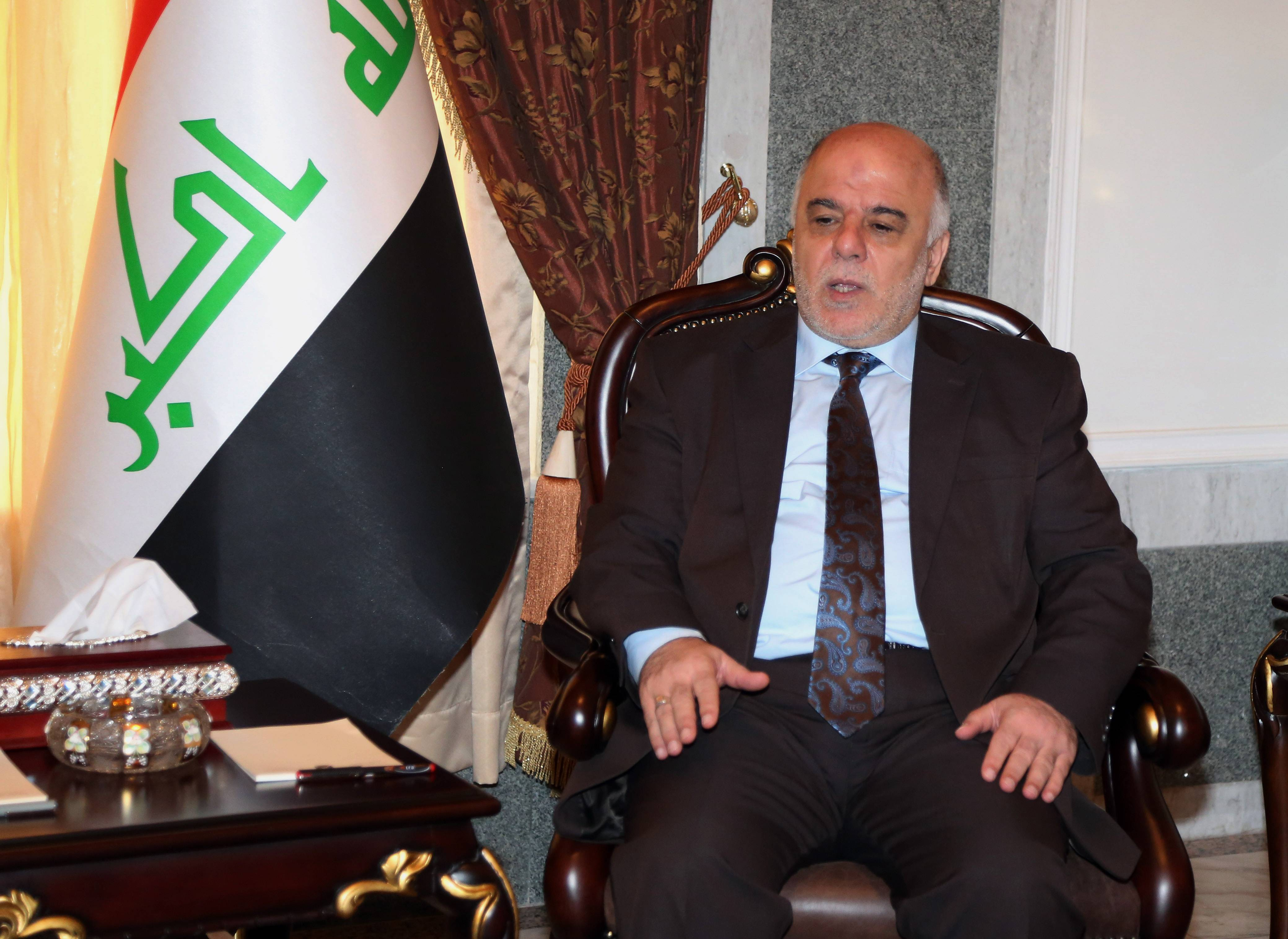 Iraqi premier-designate Haider al-Abadi meets Thursday with Pastor Farouk Yousuf in Baghdad, Iraq.