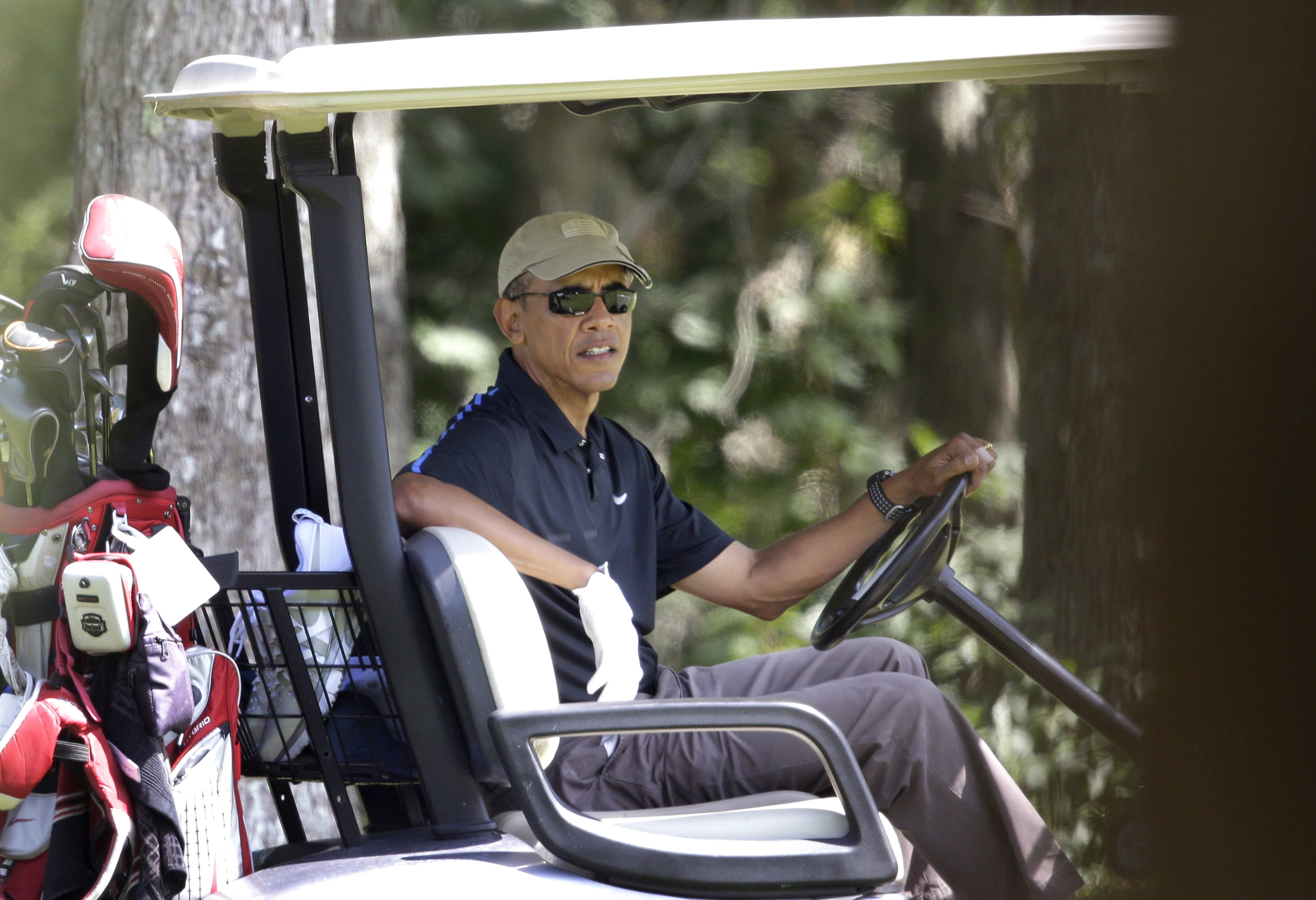 President Barack Obama sits in a golf cart Thursday while golfing at Farm Neck Golf Club, in Oak Bluffs, Mass., on the island of Martha's Vineyard.