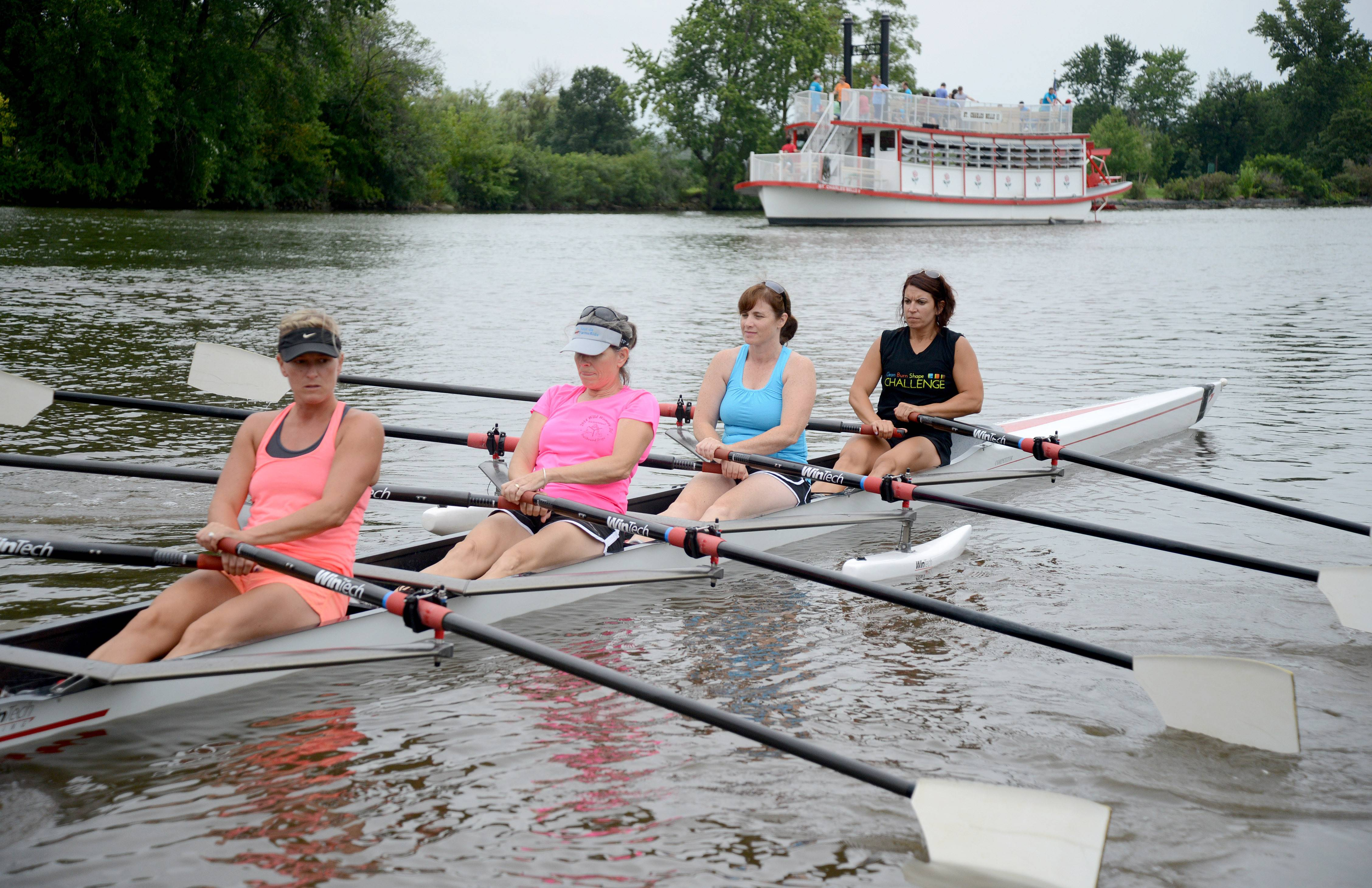 Lue Hagarty, Kendall Tokarski, Ann Fell and Heather O'Brien, all of St. Charles, learn to row Friday during a free trial class offered by Row America at Ferson Creek Park in St. Charles.