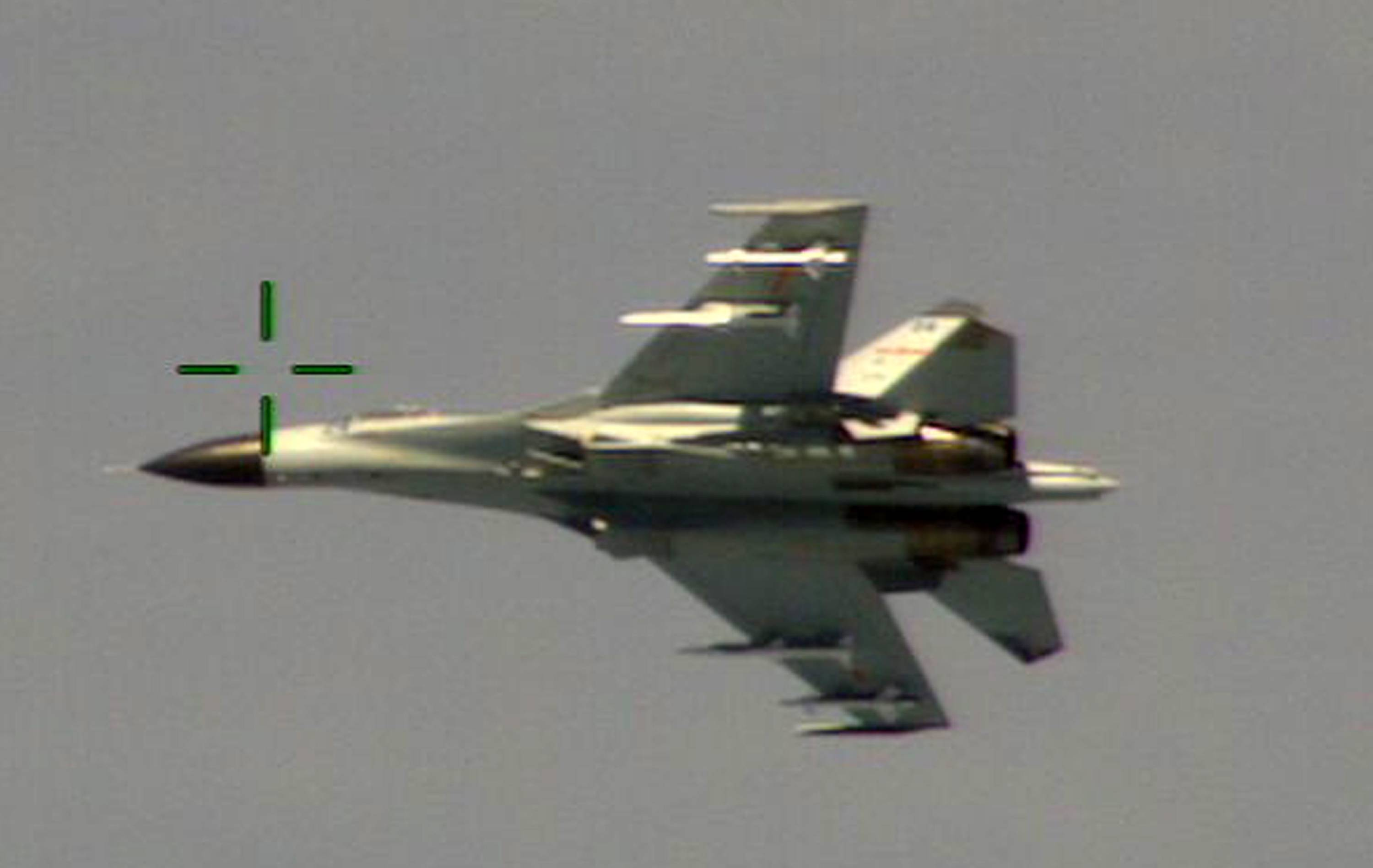 "This handout photo provided by the Office of the Defense Secretary taken Aug. 19, 2014, shows a Chinese fighter jet that the Obama administration said Friday conducted a ""dangerous intercept"" of a U.S. Navy surveillance and reconnaissance aircraft off the coast of China in international airspace."