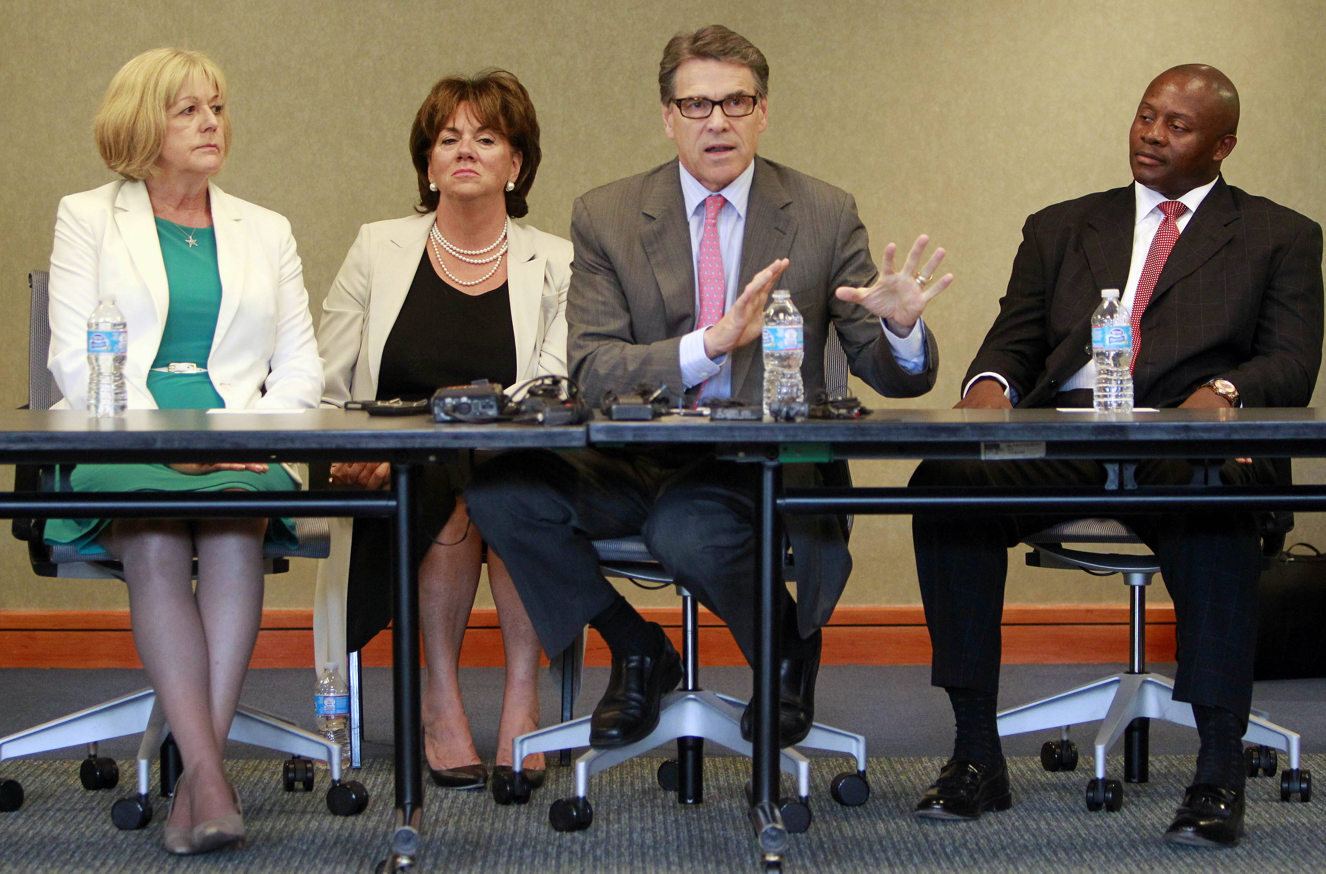 Texas Gov. Rick Perry speaks Friday to a group of business leaders in Portsmouth, N.H.