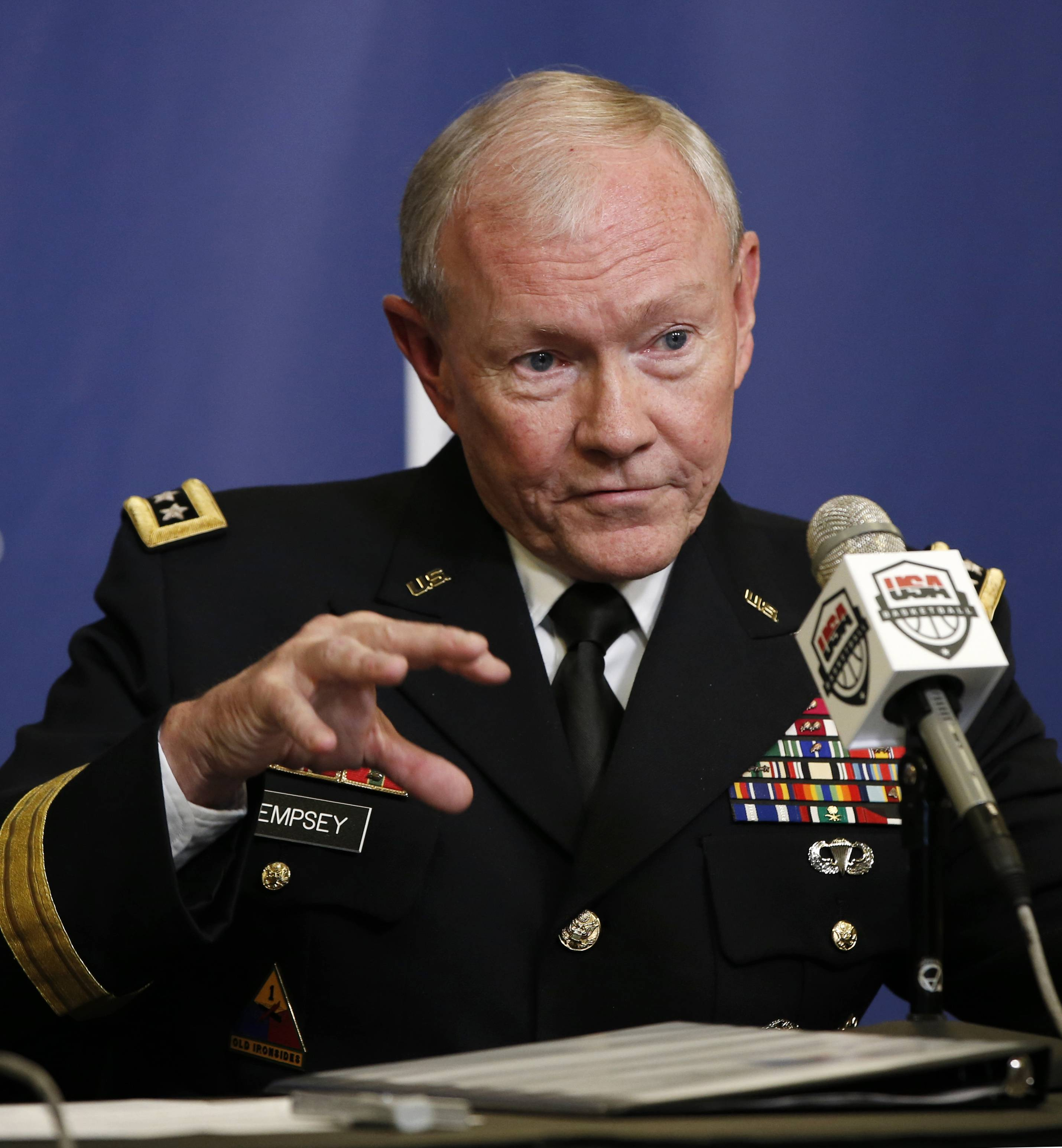 During a Pentagon briefing Thursday, Joint Chiefs Chairman Gen. Martin Dempsey said it's possible to contain the Islamic State militants, but it can't be done permanently without going after the group in Syria. Speaking to reporters with Defense Secretary Chuck Hagel, Dempsey said he wasn't predicting U.S. airstrikes in Syria, but said the problem must be addressed diplomatically, politically and militarily by America and its regional partners.