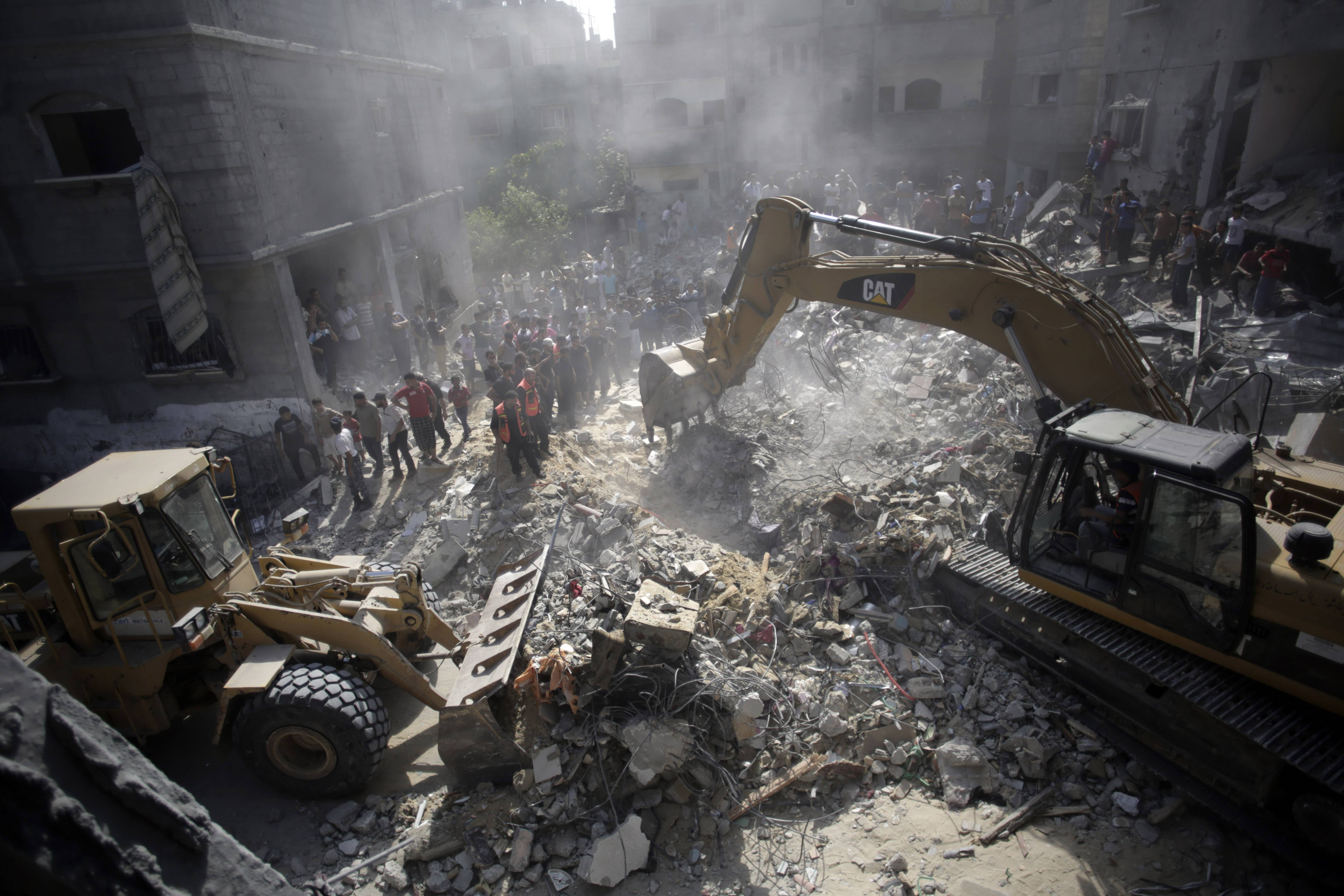 Palestinians gather around the rubble of a destroyed house Thursday following Israeli strikes in the Rafah refugee camp, Southern Gaza Strip.