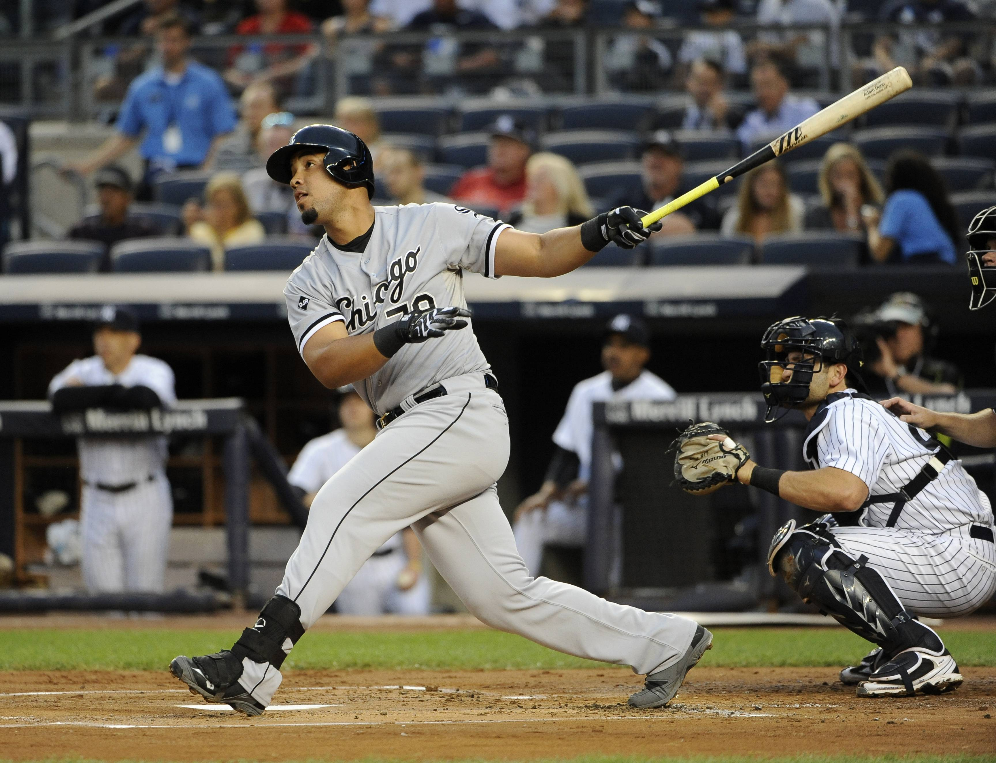 Chicago White Sox's Jose Abreu watches his three-run home run off New York Yankees starting pitcher Shane Greene as Francisco Cervelli catches for the Yankees in the first inning of a baseball game at Yankee Stadium on Friday, Aug. 22, 2014, in New York. (AP Photo/Kathy Kmonicek)