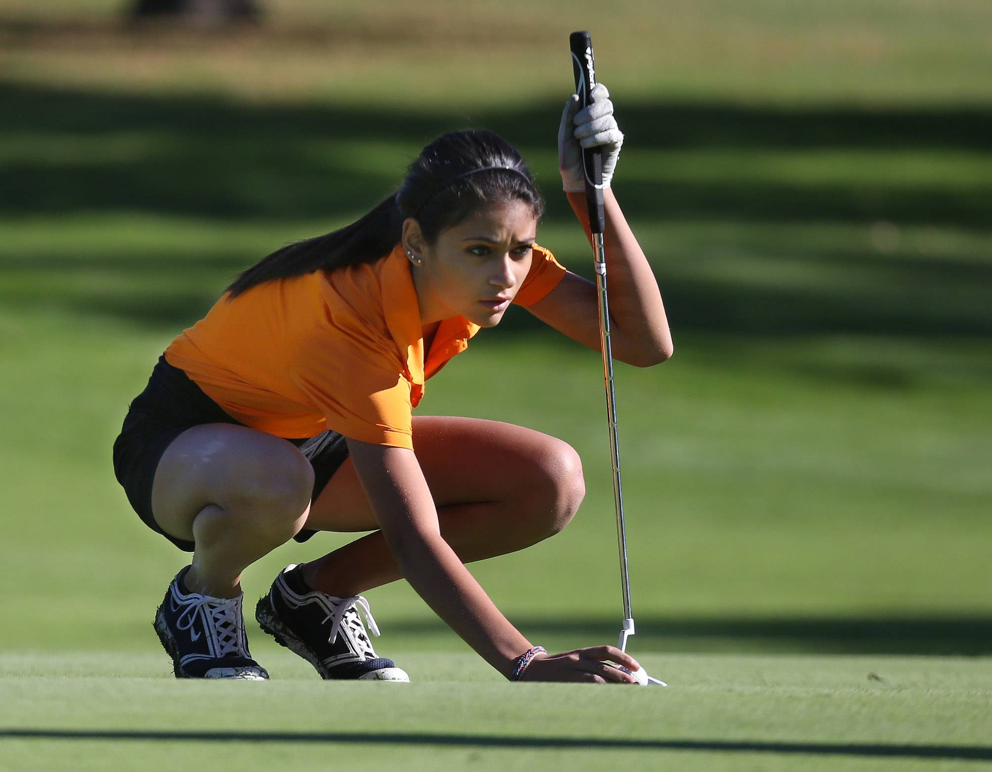 Libertyville golfer Simone Mikaelian lines up her putt on the first hole during last year's Carmel regional at Bonnie Brook Golf Course in Waukegan.
