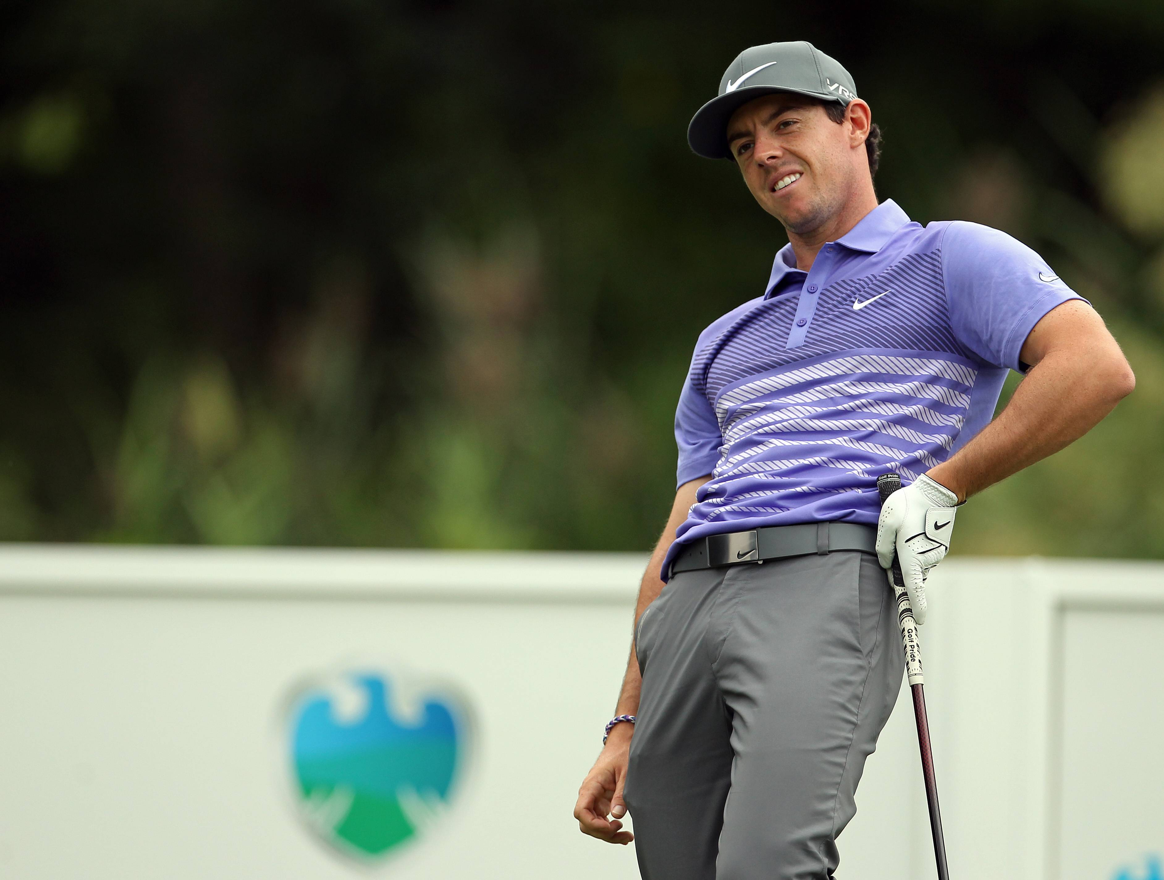 Rory McIlroy, of Northern Ireland, reacts to his tee shot on the fifth hole during second round play at The Barclays golf tournament Friday, Aug. 22, 2014, in Paramus, N.J. (AP Photo/Adam Hunger)