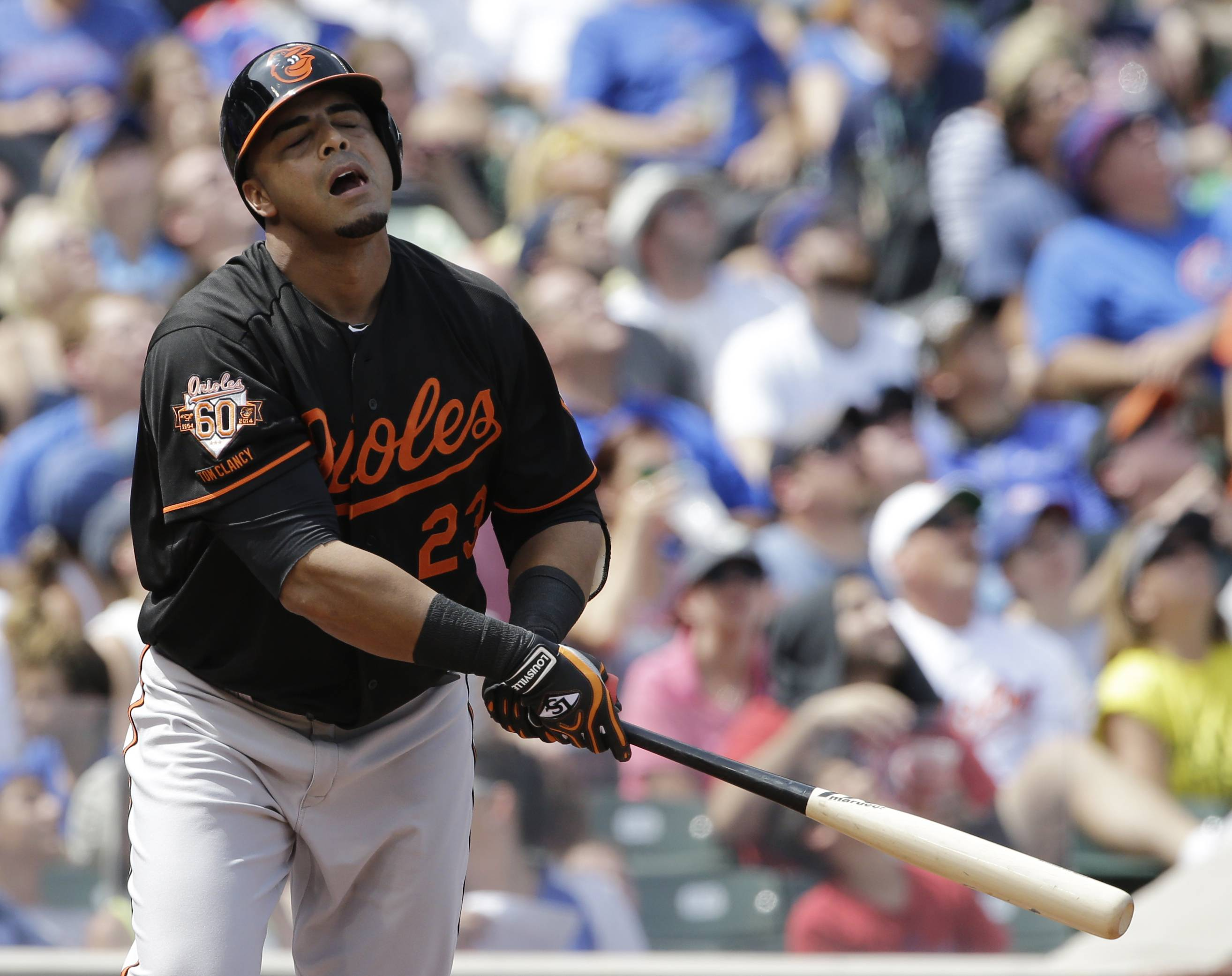 Baltimore Orioles' Nelson Cruz reacts after hitting a fly ball to Chicago Cubs third baseman Luis Valbuena during the second inning of an interleague baseball game in Chicago, Friday, Aug. 22, 2014.