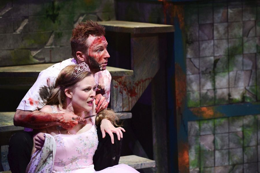 "Pursued by the Furies, the tormented Orestes (Geoff Button) takes his beloved cousin Hermione (Erin Barlow) hostage in ""All Our Tragic,"" running through Oct. 5 at The Den Theatre in Chicago."