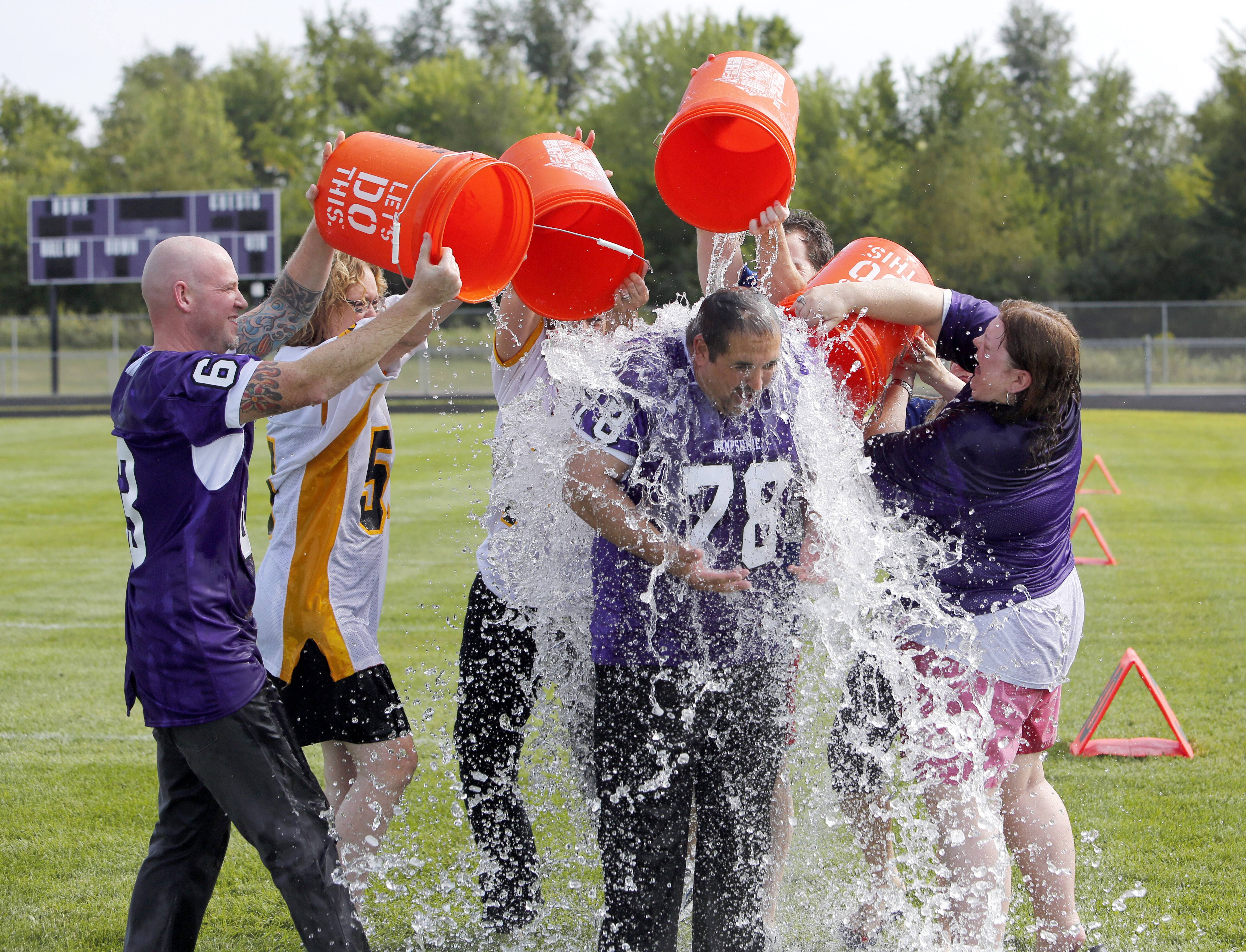 District 300 CEO and future Superintendent Fred Heid, center, is doused with four 5-gallon buckets of ice water by the administrators who also took the ALS ice bucket challenge Friday at Hampshire High School.
