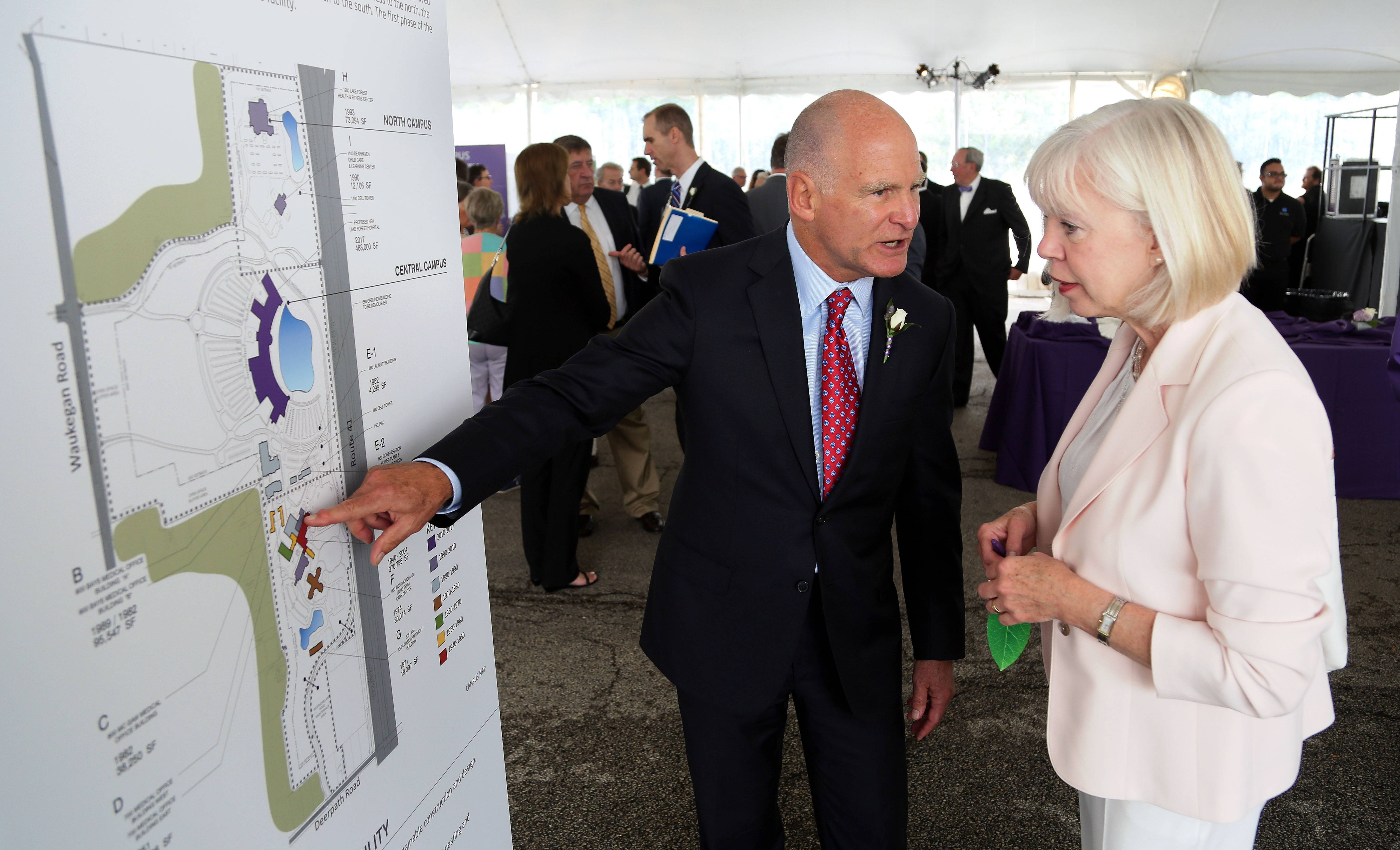 Tim Zoph, left, senior vice president of Northwestern Medicine, looks at plans with Maria Sinclair of the Grainger Foundation during Friday's groundbreaking ceremony for the new building at Northwestern Medicine Lake Forest Hospital.