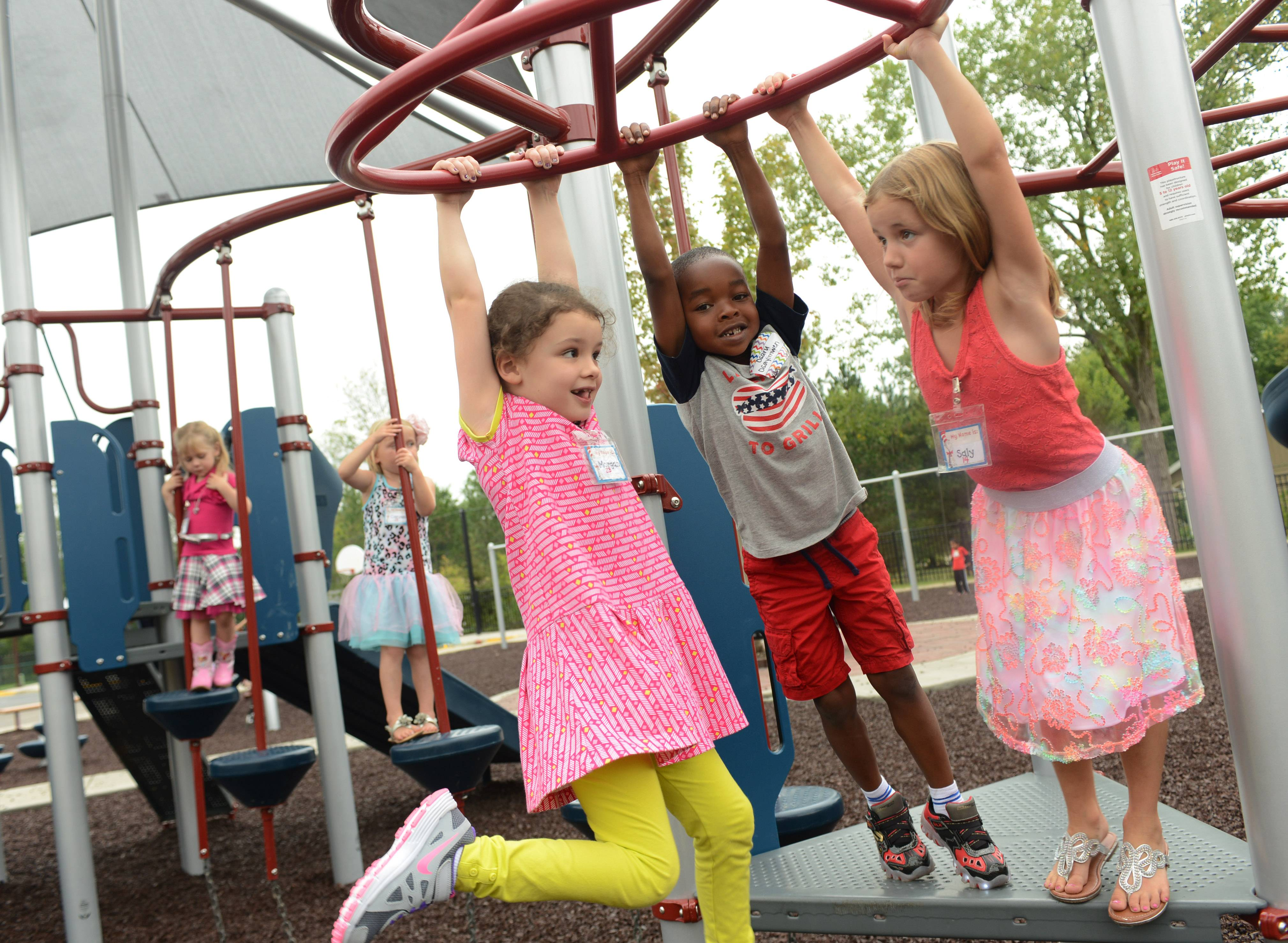 Oak Grove Elementary School kindergarten students test out the new playground Friday during first day of school in Green Oaks.