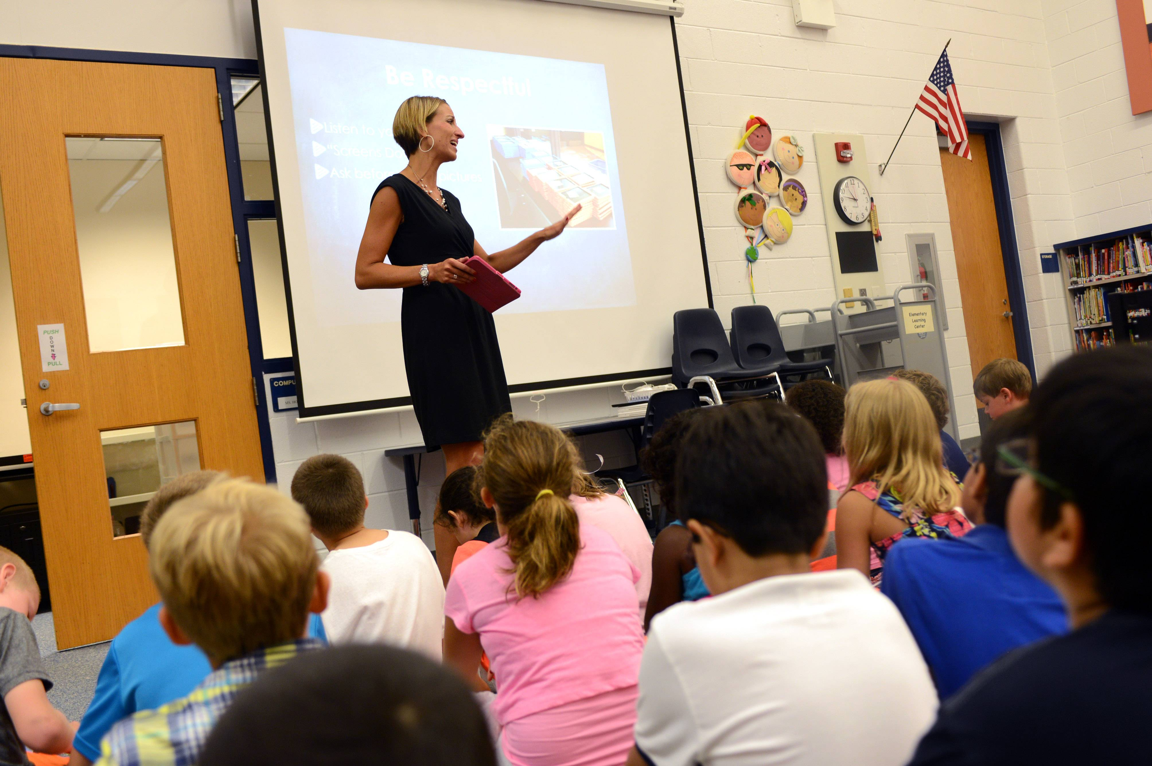 Oak Grove Elementary School technology specialist Allison Honaker gives an iPad overview to students Friday in Green Oaks.