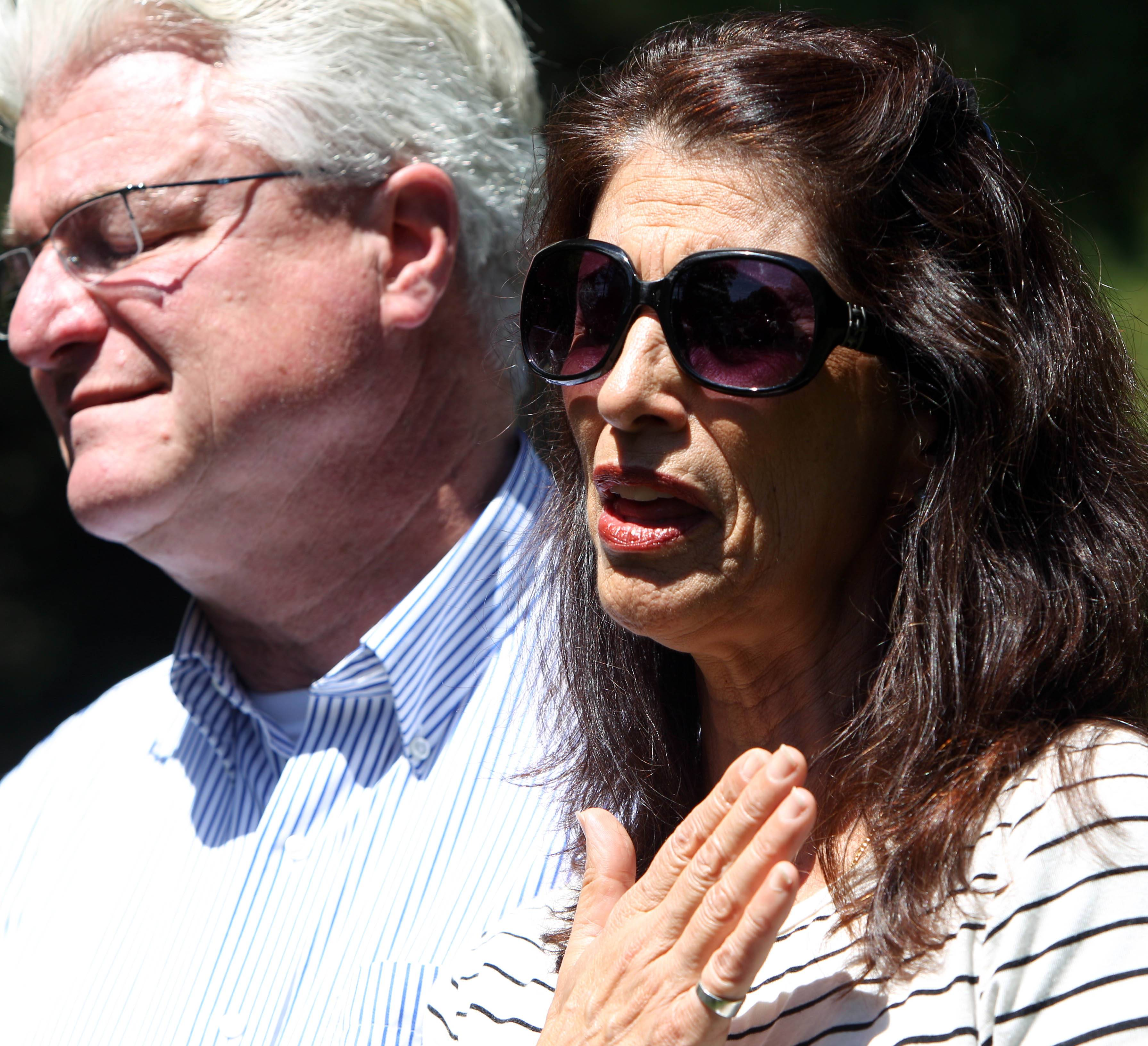 "Diane and John Foley talk to reporters outside their home in Rochester, N.H. Speaking on NBC's ""Today,"" the parents of slain journalist James Foley said they regarded an email they received from his captors last week as a hopeful sign they could negotiate with the Islamic militants."