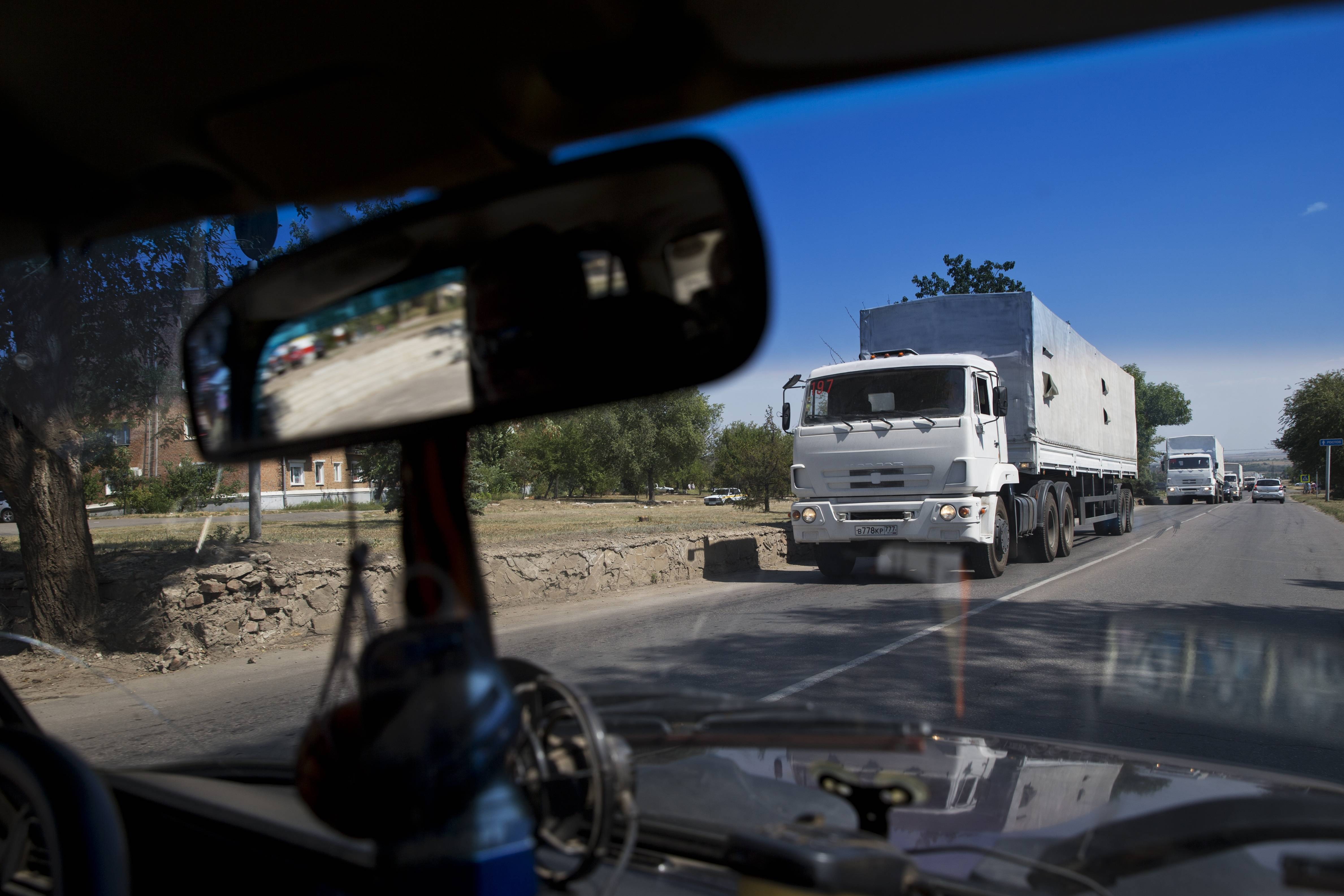 Trucks move Friday toward a border control point with Ukraine in the Russian town of Donetsk, Rostov-on-Don region. The first trucks of the Russian aid convoy crossed the Ukrainian inspection zone Friday morning.