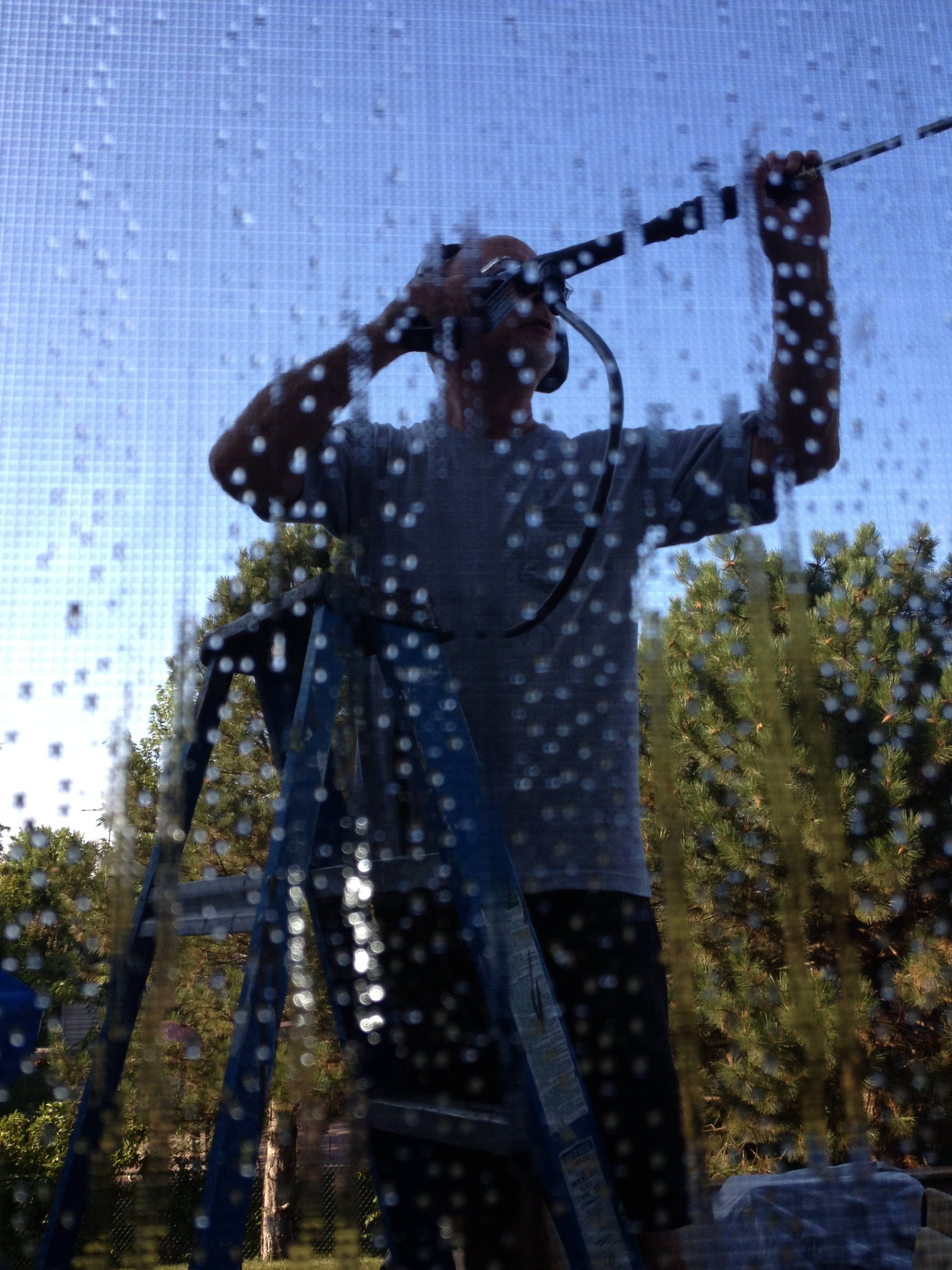 "I thought this photo was a bit abstract. I sent it to my sisters and they replied, ""what is it?"" This is my husband, Joe at combat with the power washer at our house."