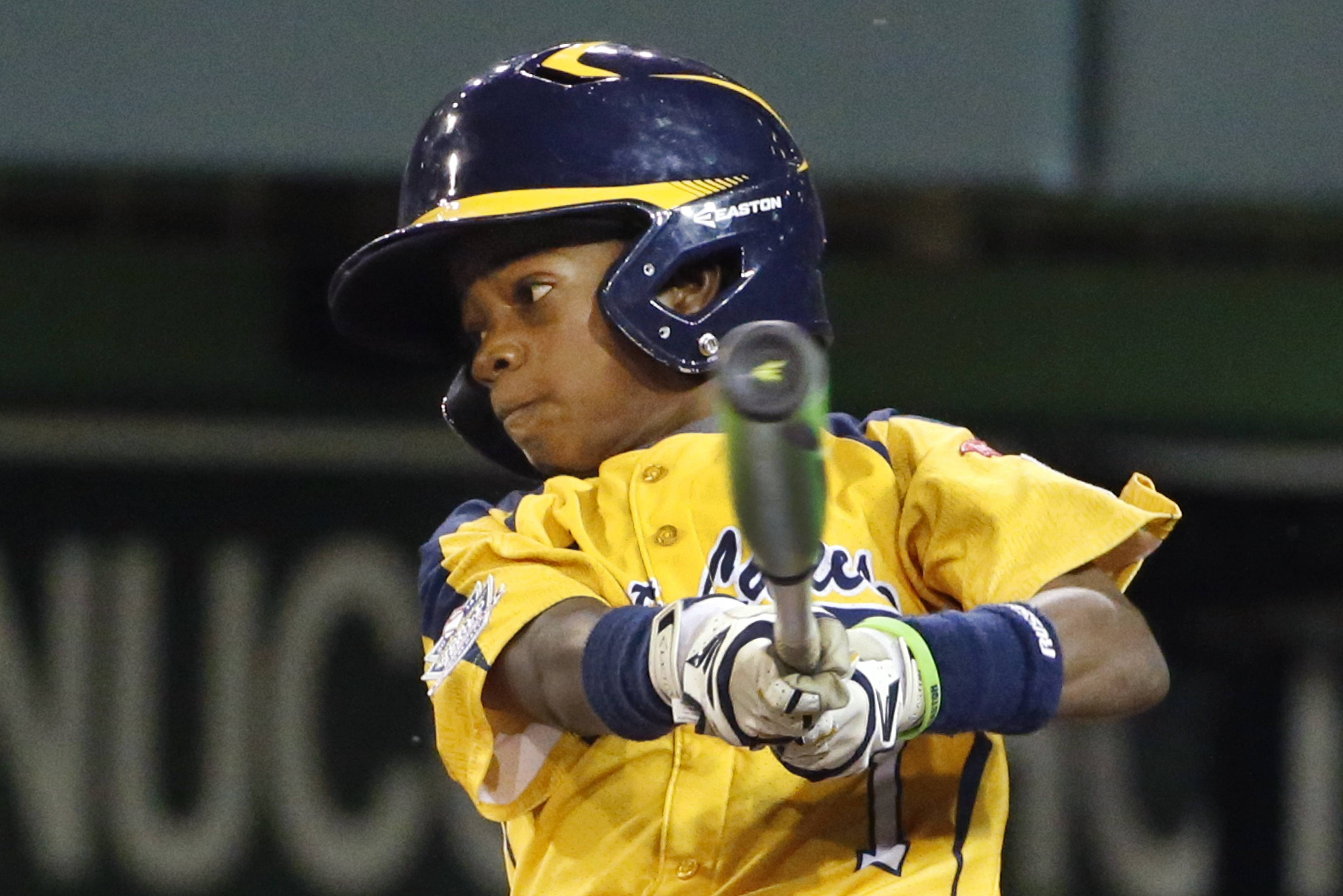Chicago's DJ Butler drives in 2 runs with a single in the first inning of his team's victory over Philadelphia on Thursday. The Jackie Robinson West team has a rematch against Nevada today in the U.S. final.