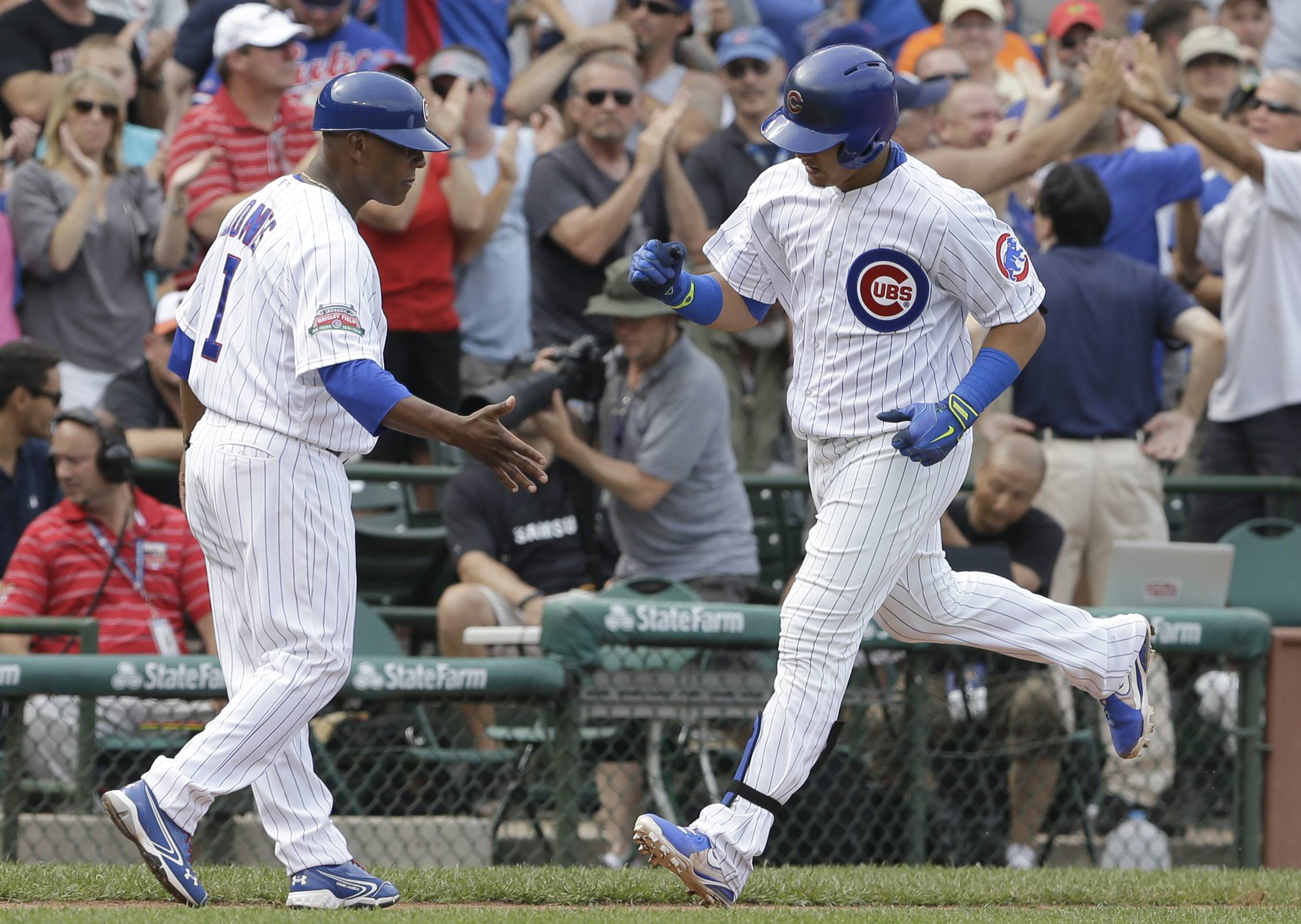 Javier Baez, right, celebrates with third base coach Gary Jones after hitting his sixth home run of the season Friday.