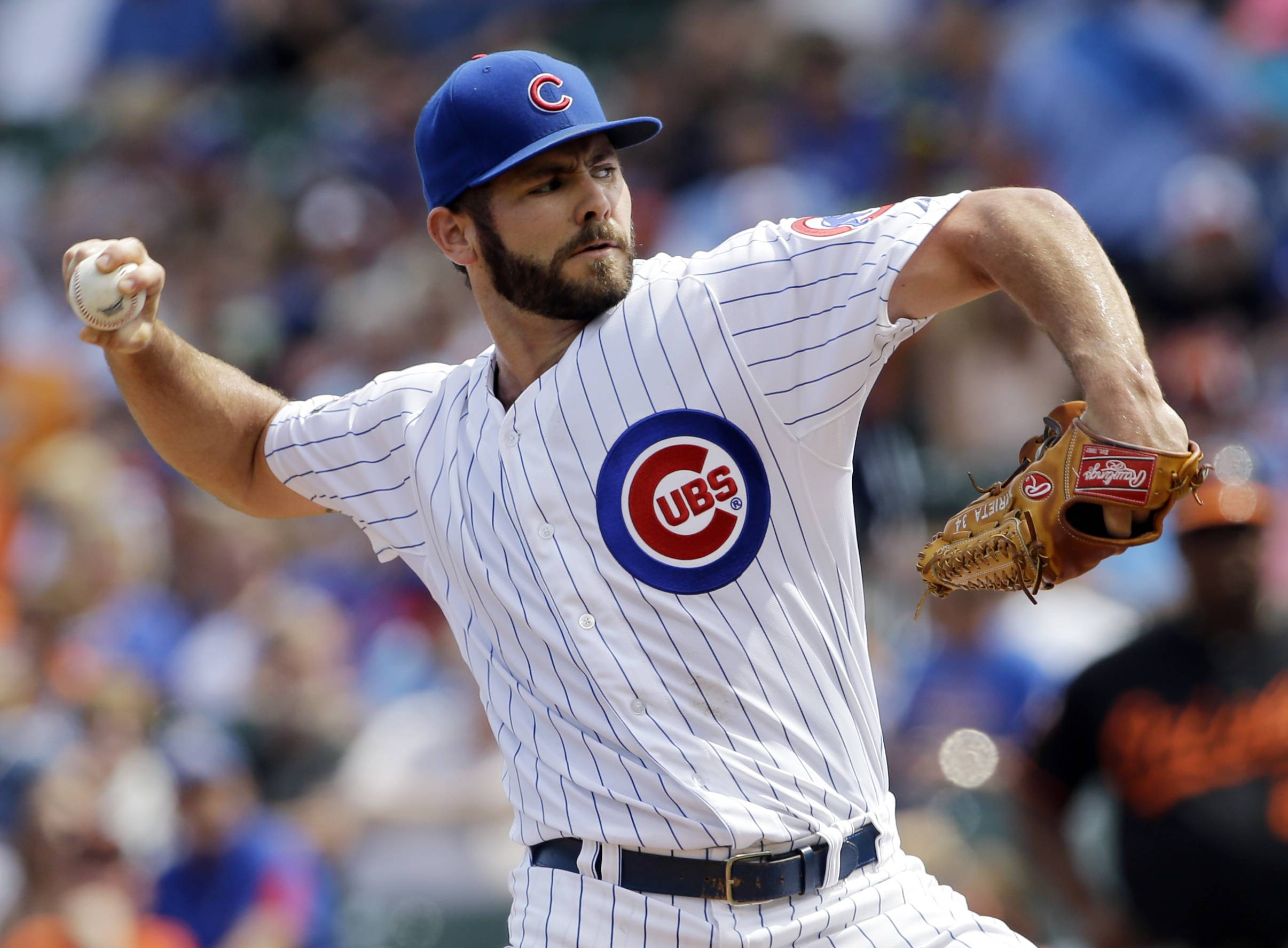 Chicago Cubs starter Jake Arrieta throws against the Baltimore Orioles during the first inning of an interleague baseball game in Chicago, Friday, Aug. 22, 2014.
