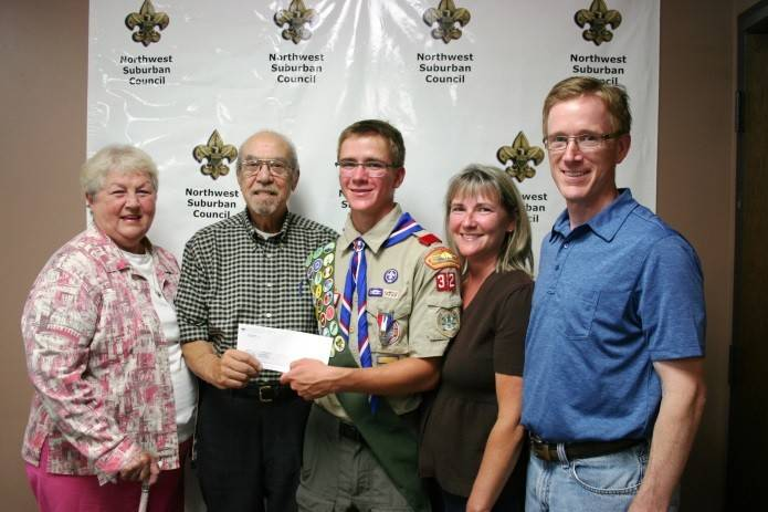 Margaret and Mario DiLullo, Eagle Scout David Mercker and his parents, Kristen and Andrew, as David receives the 2014 DiLullo Scholarship check for $500.