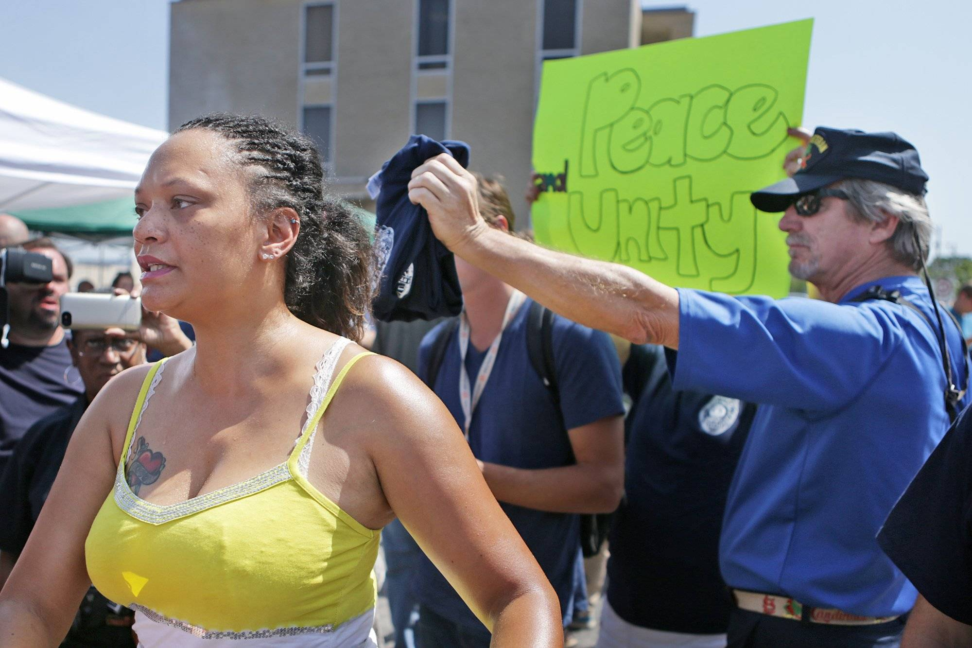 "Sondra Fifer, of St. Louis, voices her disagreement with the rally Saturday for Ferguson police Officer Darren Wilson, at Barney's Sports Pub in St. Louis. ""I'm not against officers, I'm against police brutality,"" Fifer said. Ferguson's streets remained peaceful, though, as tensions between police and protesters continued to subside."