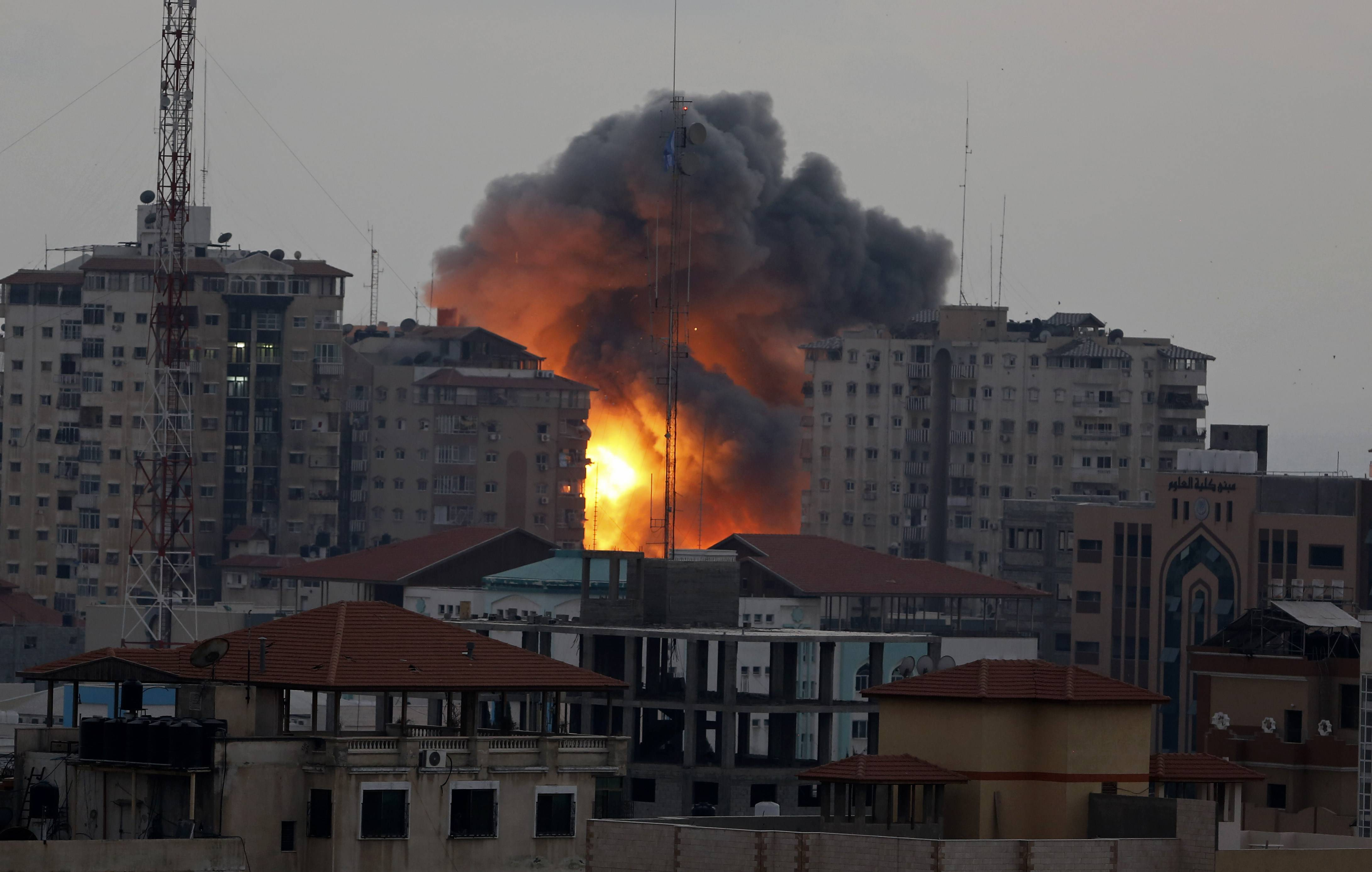 A ball of fire rises from an explosion Saturday on al-Zafer apartment tower following an Israeli air strike in Gaza City.