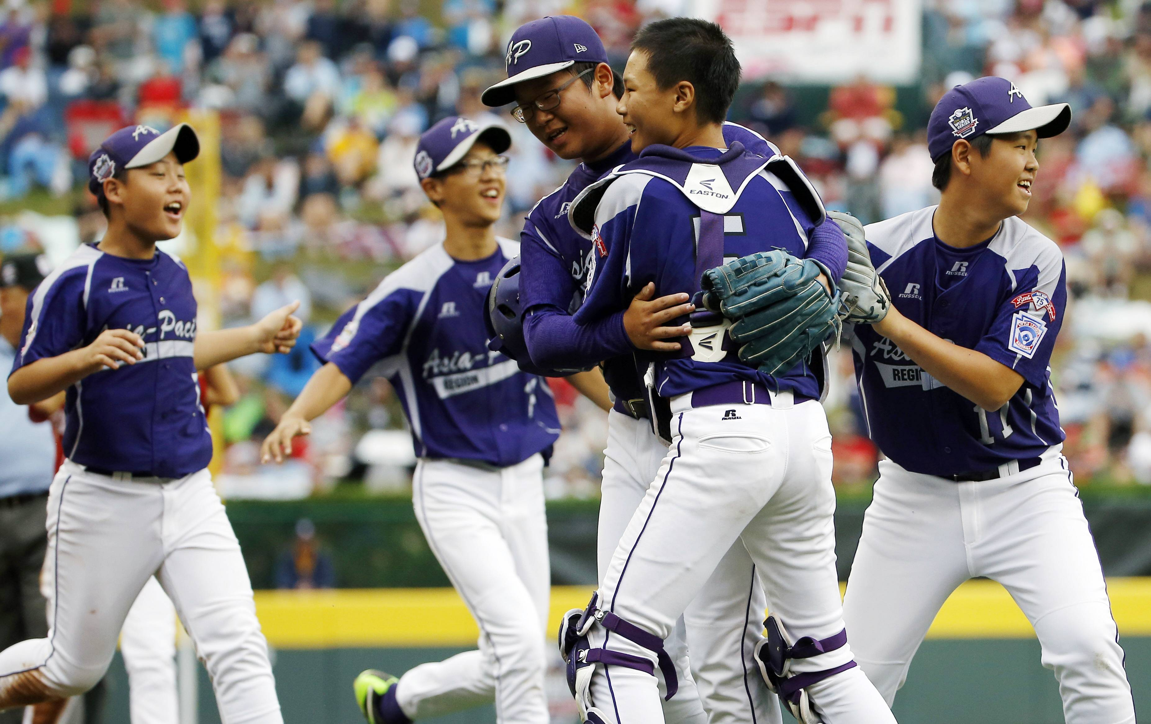 South Korea players celebrate after defeating Japan 12-3 on Saturday in the International final at the Little League World Series in South Williamsport, Pa.