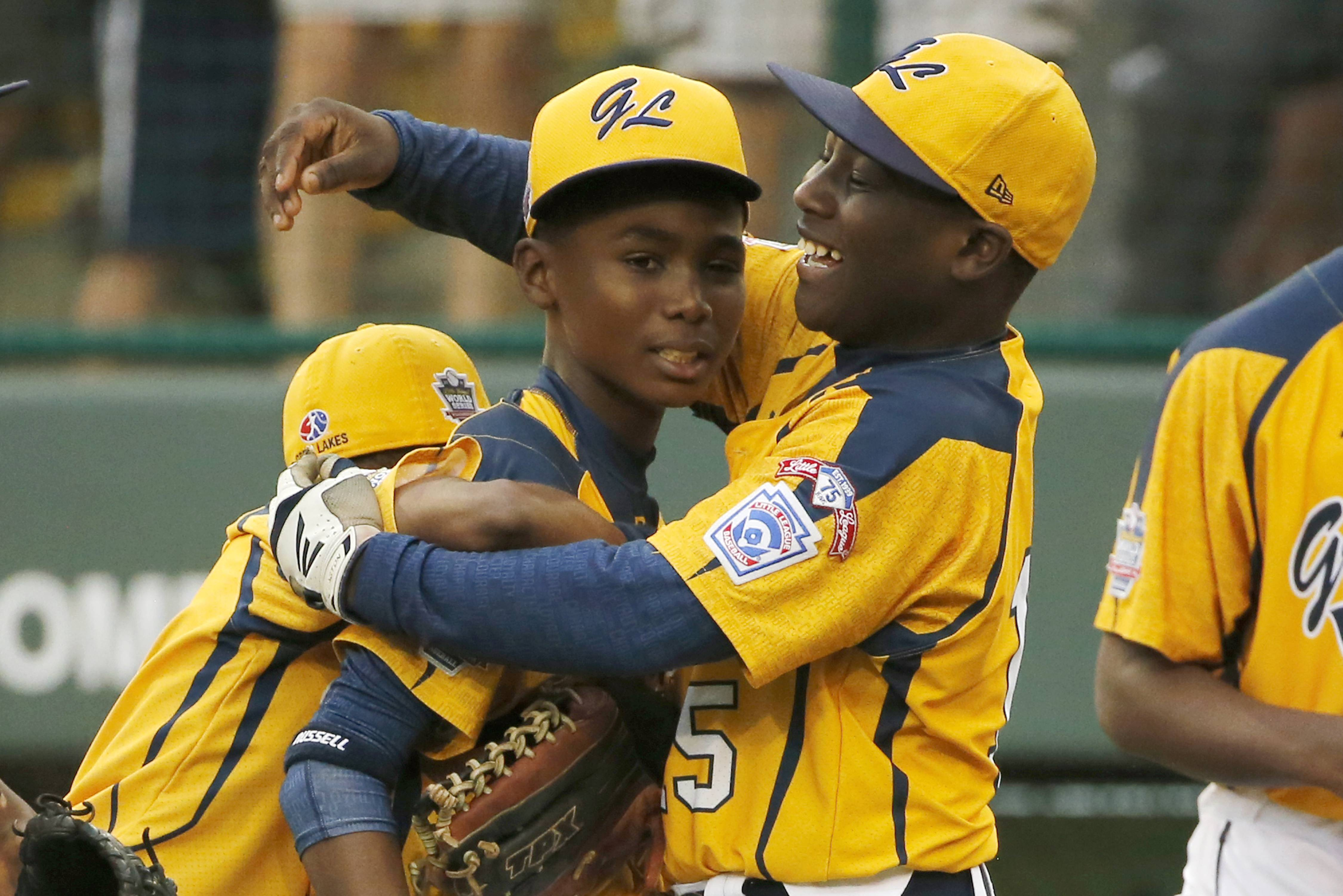 Chicago's Joshua Houston, right, embraces Ed Howard after a 7-6 win in the U.S. final against Las Vegas on Saturday at the Little League World Series in South Williamsport, Pa.