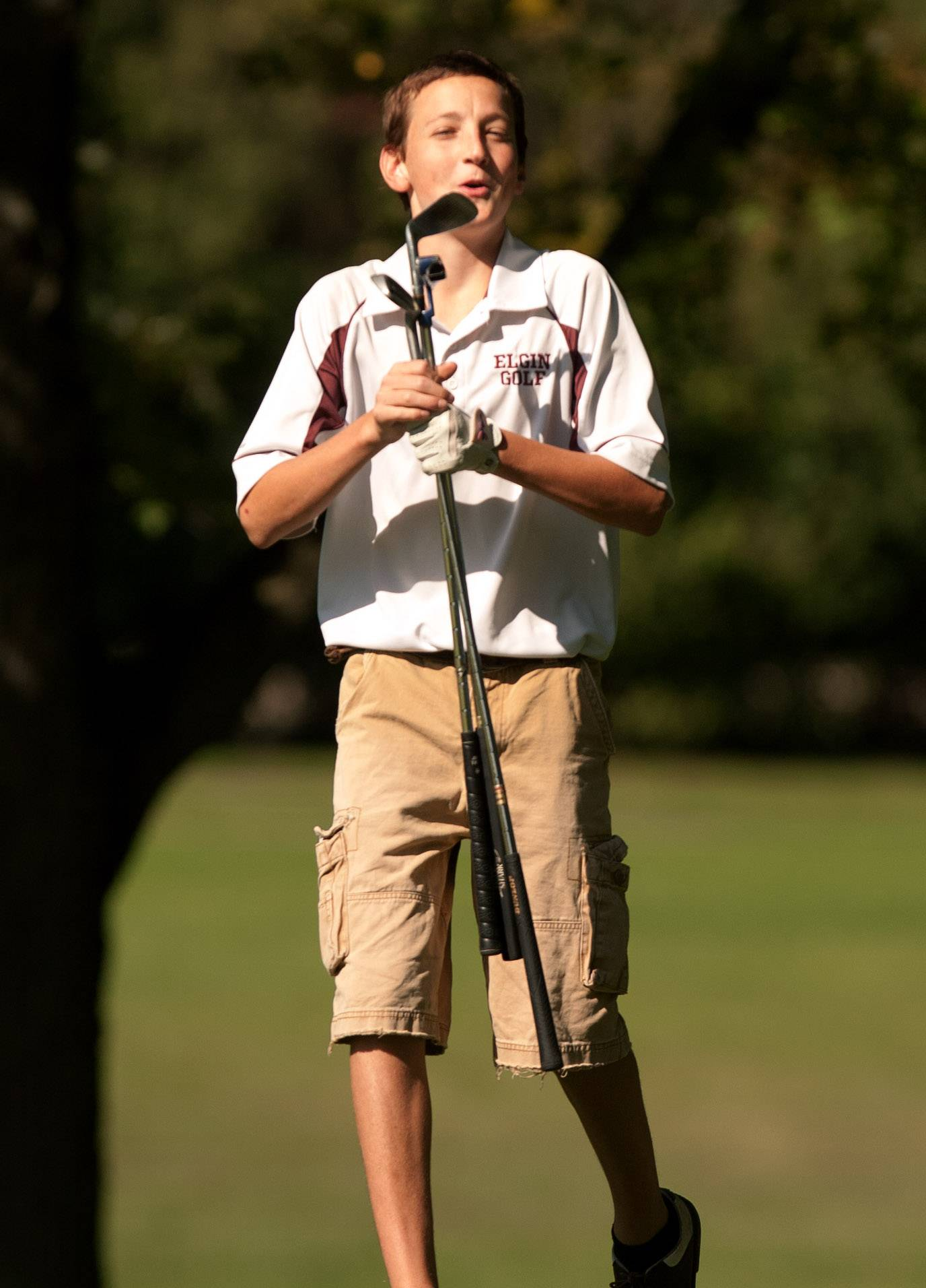 As he gathers his clubs, Elgin's Josh Hegel reacts to sinking a 35-foot putt during the Upstate Eight Conference boys golf tournament at St. Andrews Country Club last season.