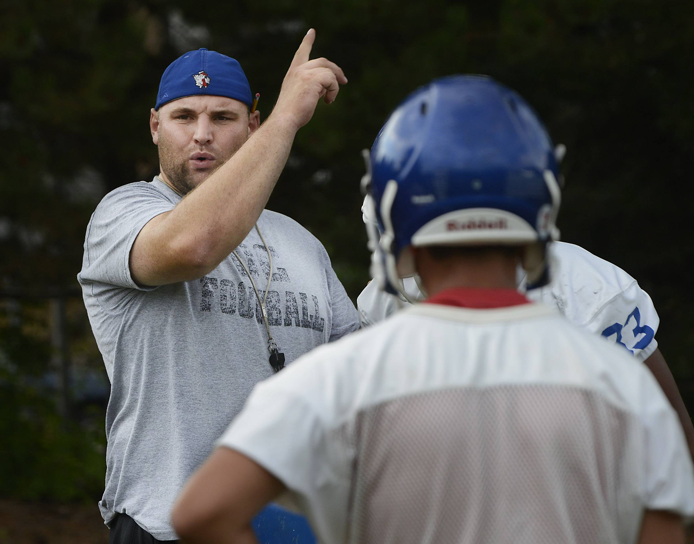 New Dundee-Crown head football coach Mike Steinhaus directs drills during the first day of practice.