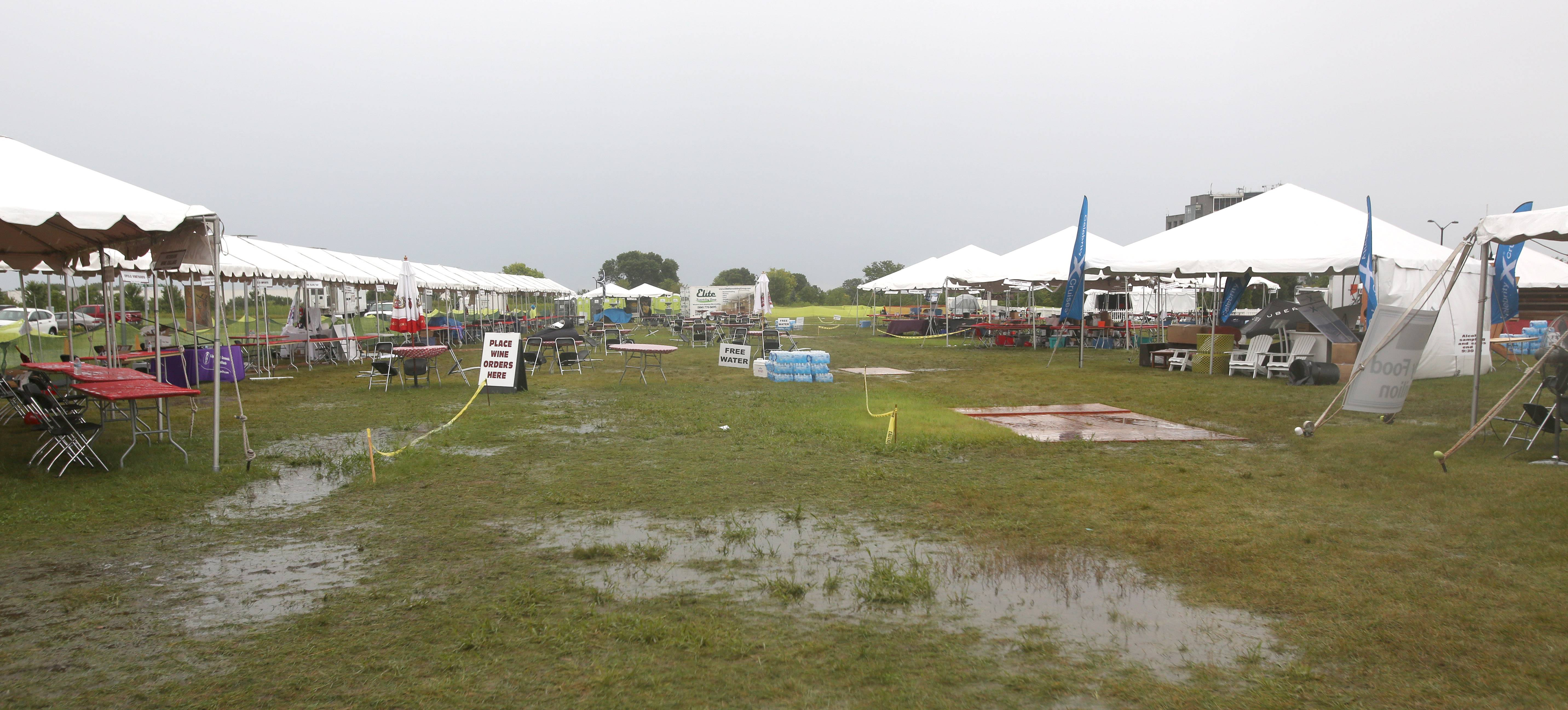 Saturday's start of the 12th annual Naperville Wine Fest at the CityGate Centre was delayed two hours to 5 p.m. due to fear of lightning following heavy rains.