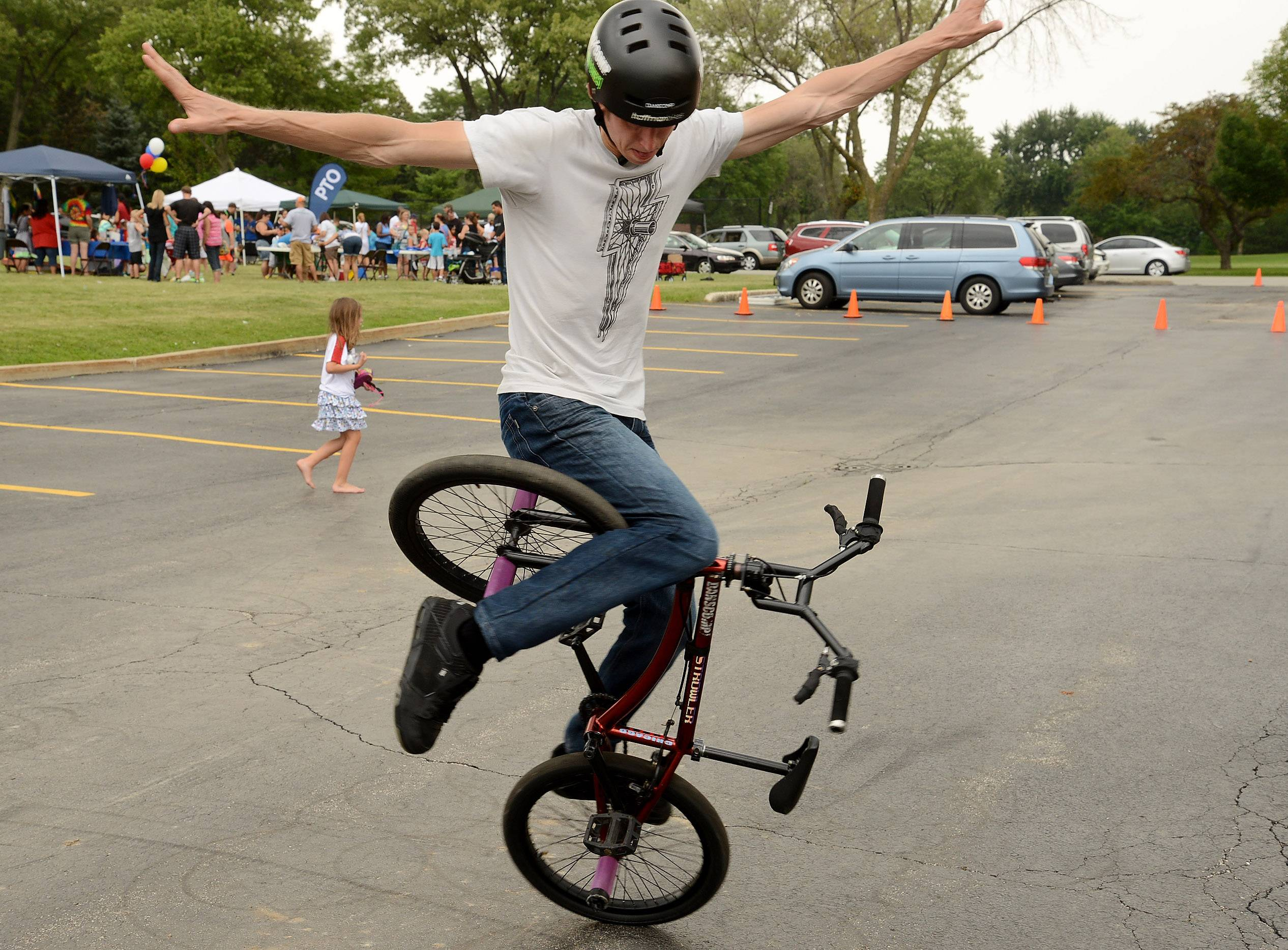 BMX Champion Matt Wilhelm of Naperville demonstrates riding BMX Flatland at the Elk Grove Township Elementary District 59 back-to-school celebration Saturday at Grove Junior High School in Elk Grove Village.