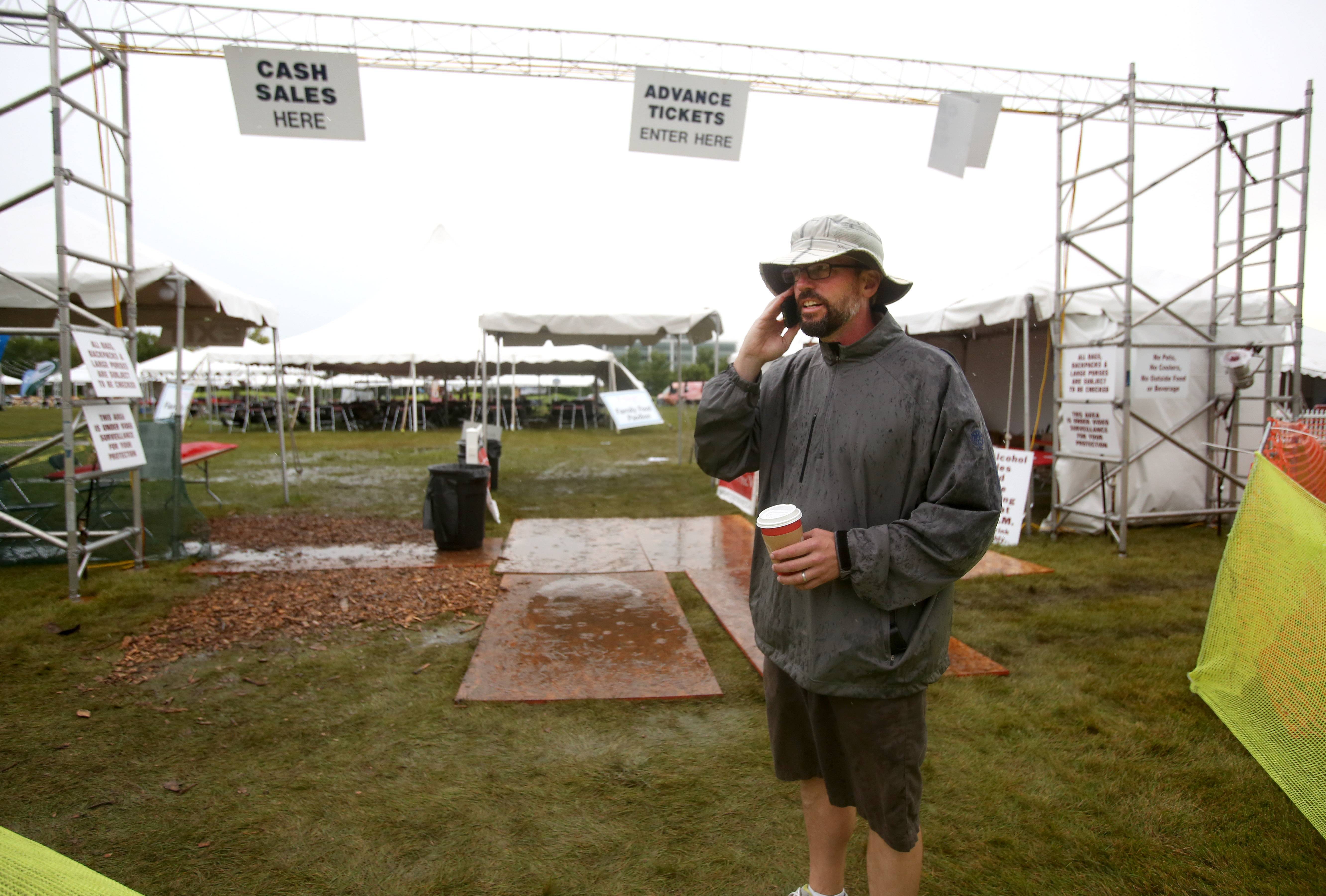 Scott Janess, president of Inplay Events, which has organized the 12th annual Naperville Wine Fest, delays the start of this CityGate Centre event two hours to 5 p.m. due to bad weather.