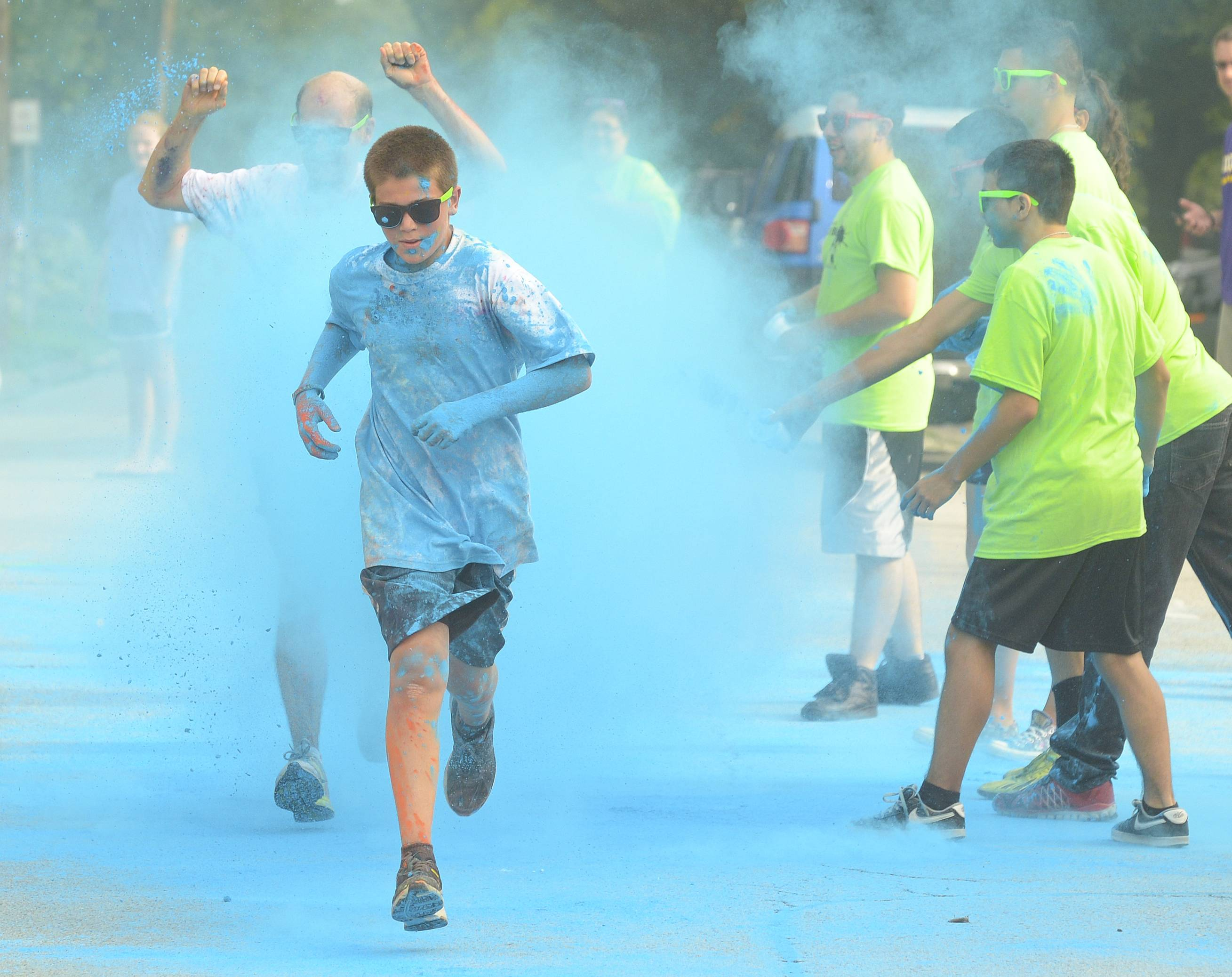 Max Wexley, 12 of Palatine crosses the finish line and gets pelted with colored powder Saturday during the 2nd annual Active Care ColorBlast 5K in Arlington Heights to support Clearbrook.