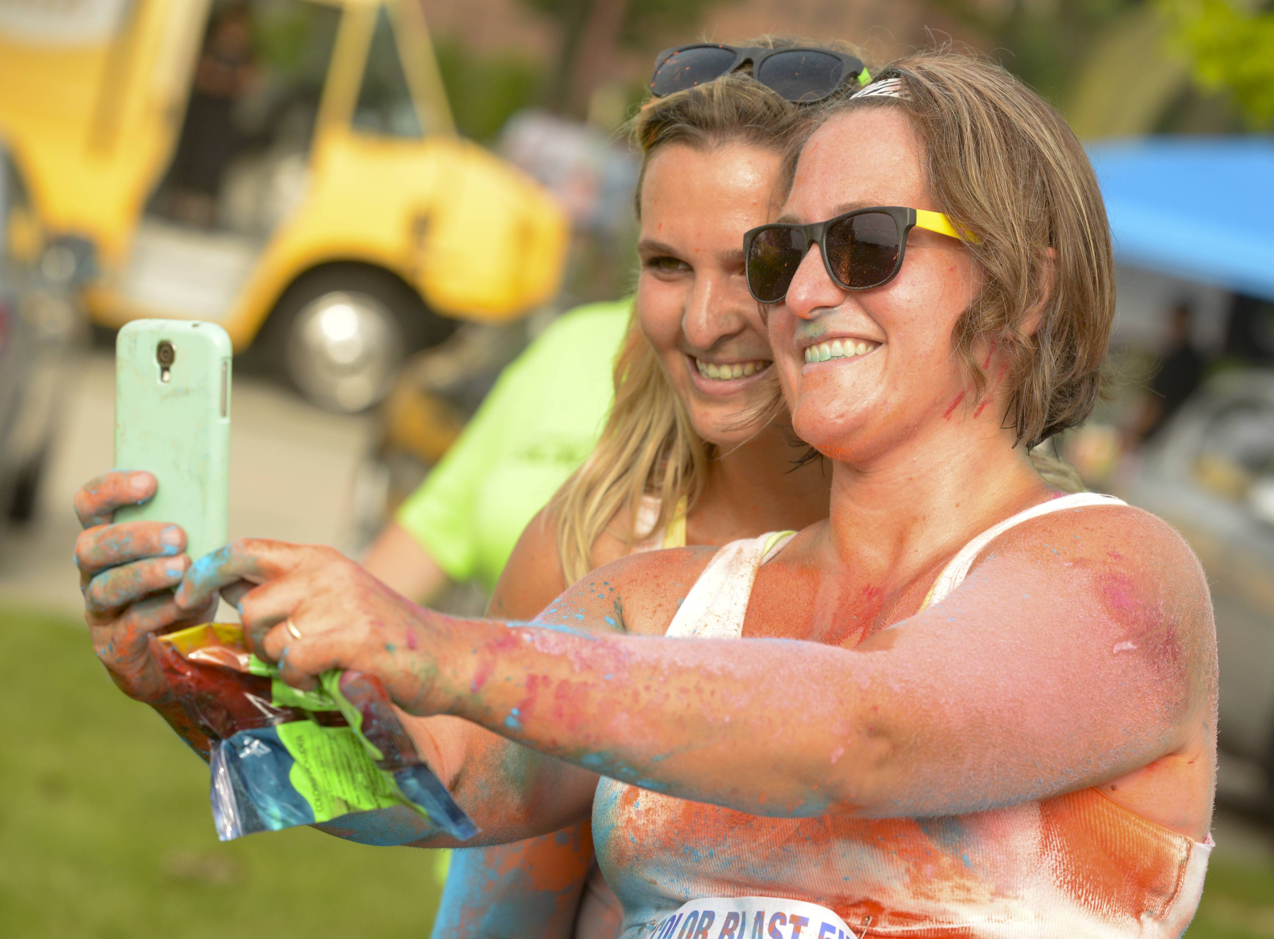 Courtney Joyce of Lake in the Hills and Maria Churak of Fox River Grove take a selfie after finishing their first color run Saturday, the 2nd annual Active Care ColorBlast 5K in Arlington Heights to support Clearbrook.