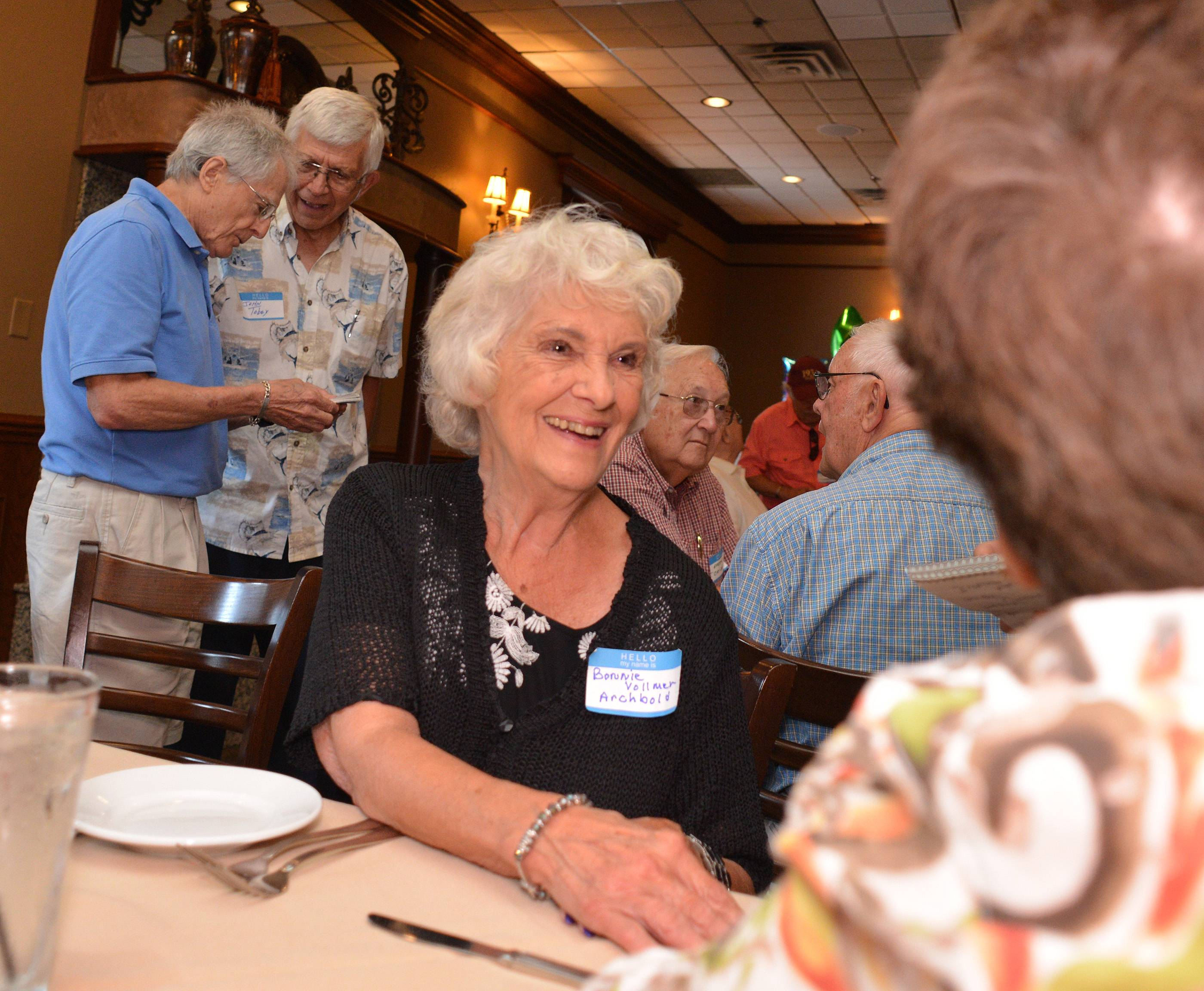 Bonnie Archbold, center, of West Chicago, chats with members of the Glenbard West Class of 1952.