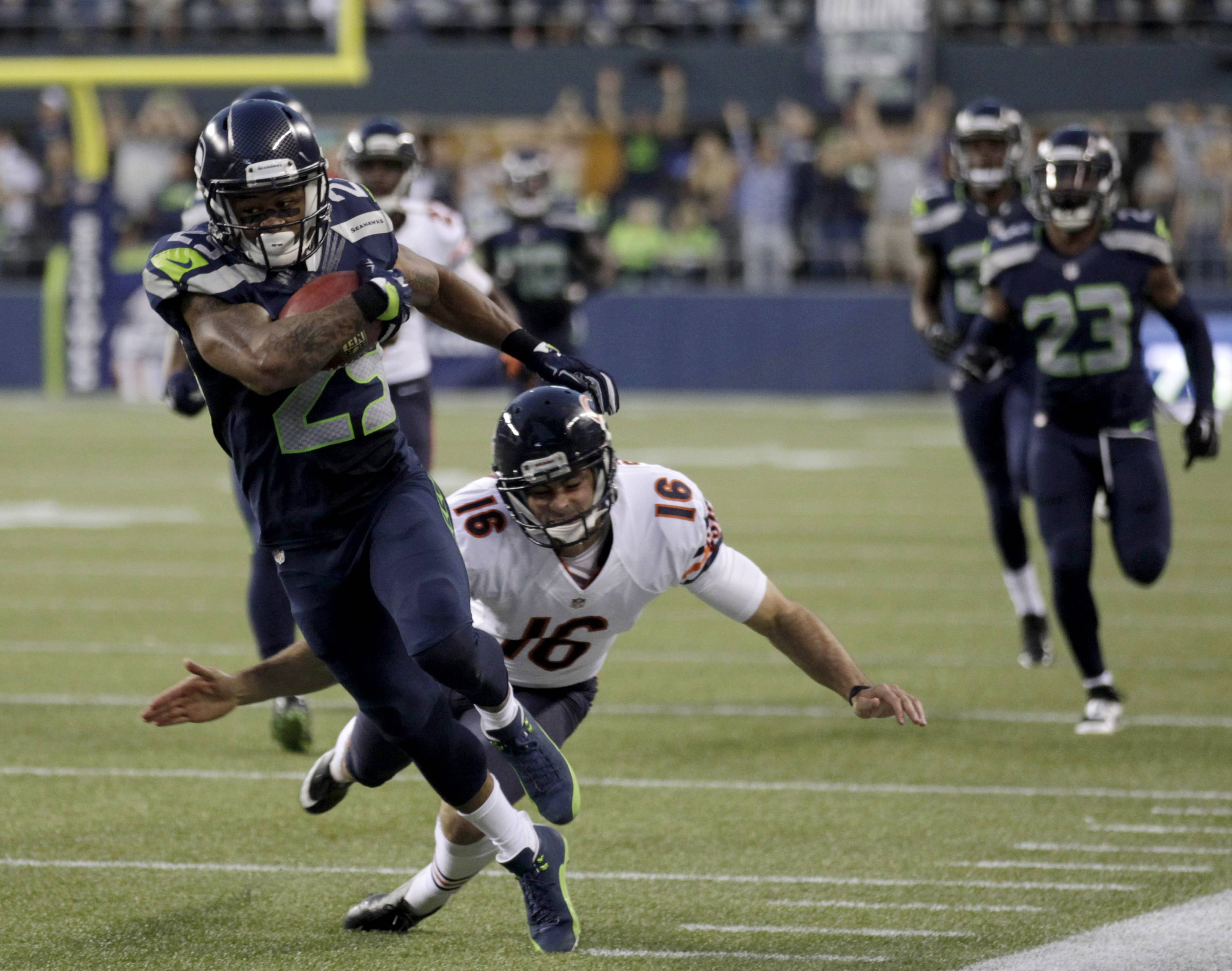The Seahawks' Earl Thomas, left, nearly returns a punt for a touchdown Friday night before Bears punter Pat O'Donnell makes the tackle.