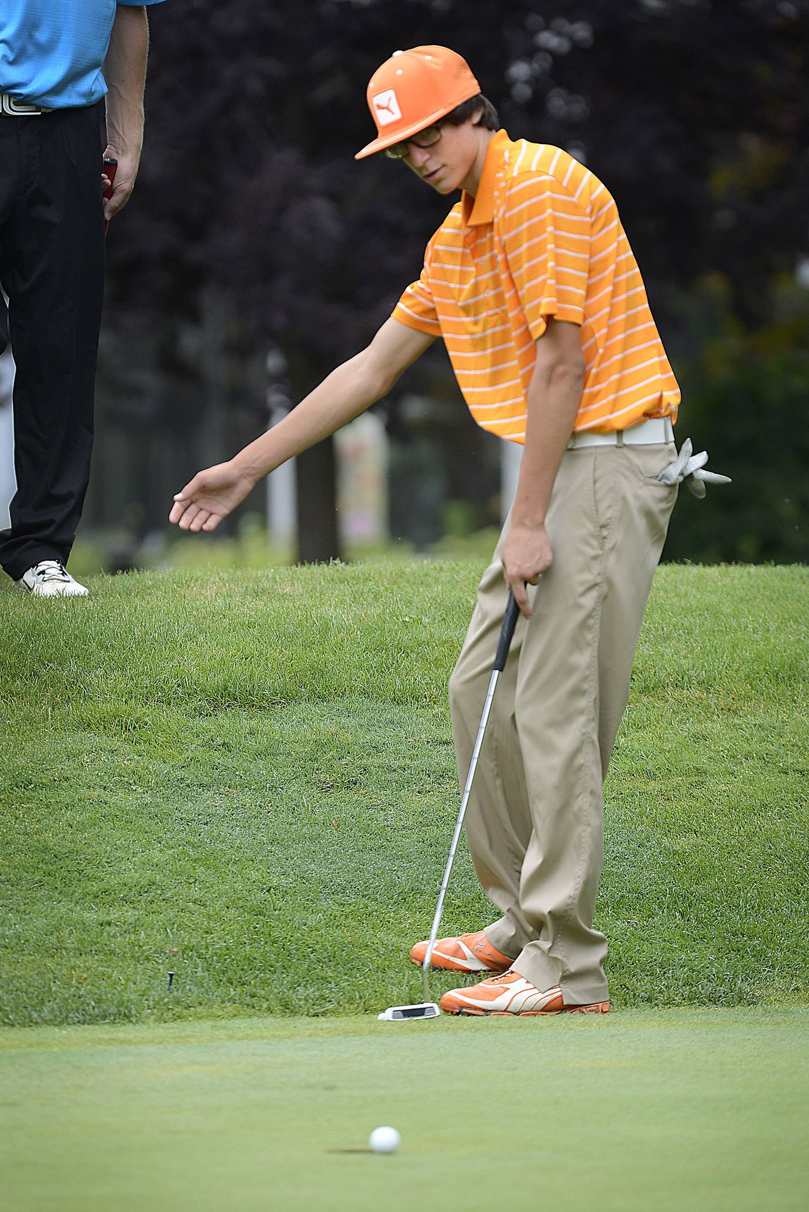 St. Charles East's Ronnie Griggs coaxes a putt Monday during the McChesney Cup at the Geneva Golf Club in Geneva.