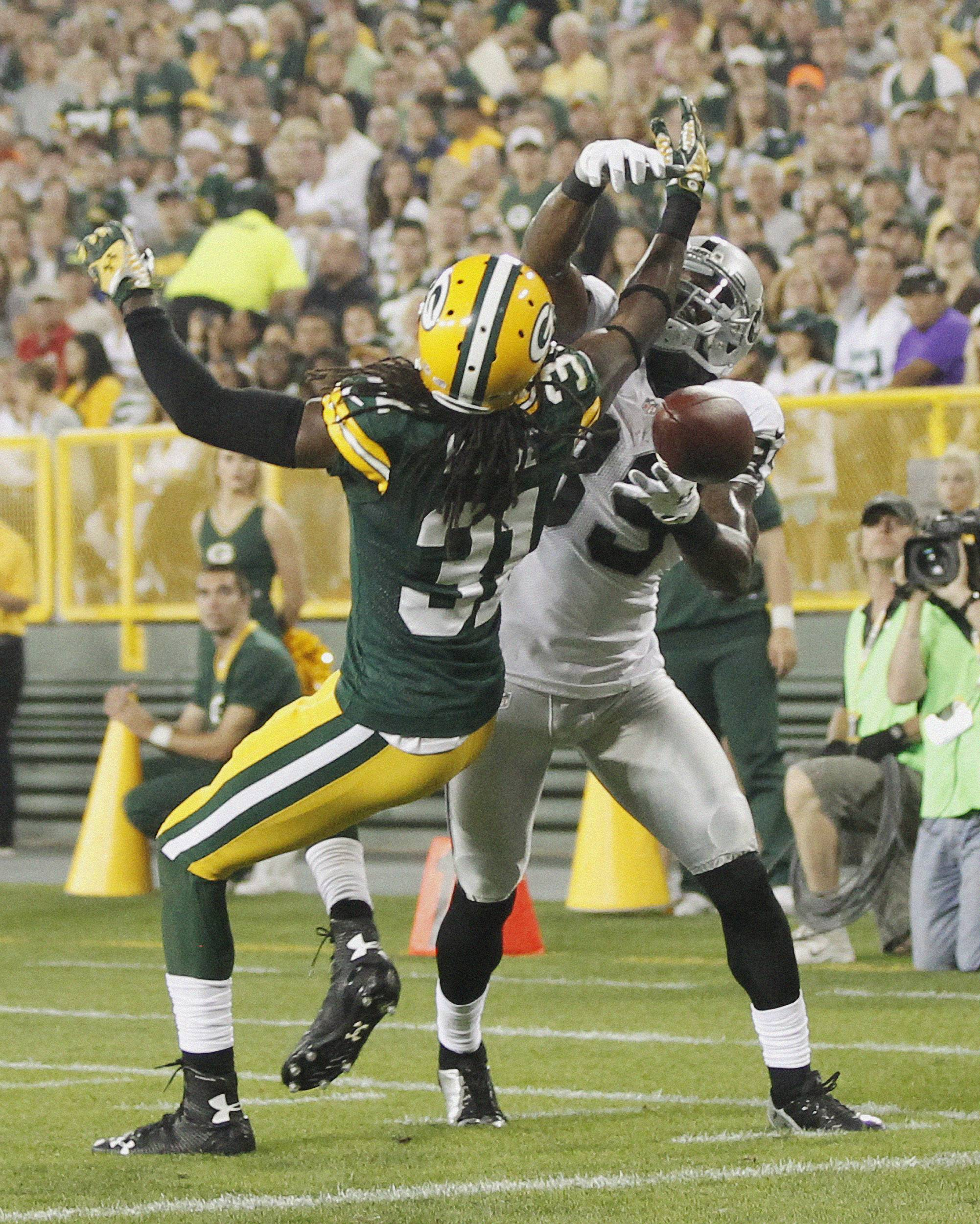 Green Bay Packers' Davon House breaks up a pass intended for Oakland Raiders' James Jones during the first half of an NFL preseason football game Friday, Aug. 22, 2014, in Green Bay, Wis.