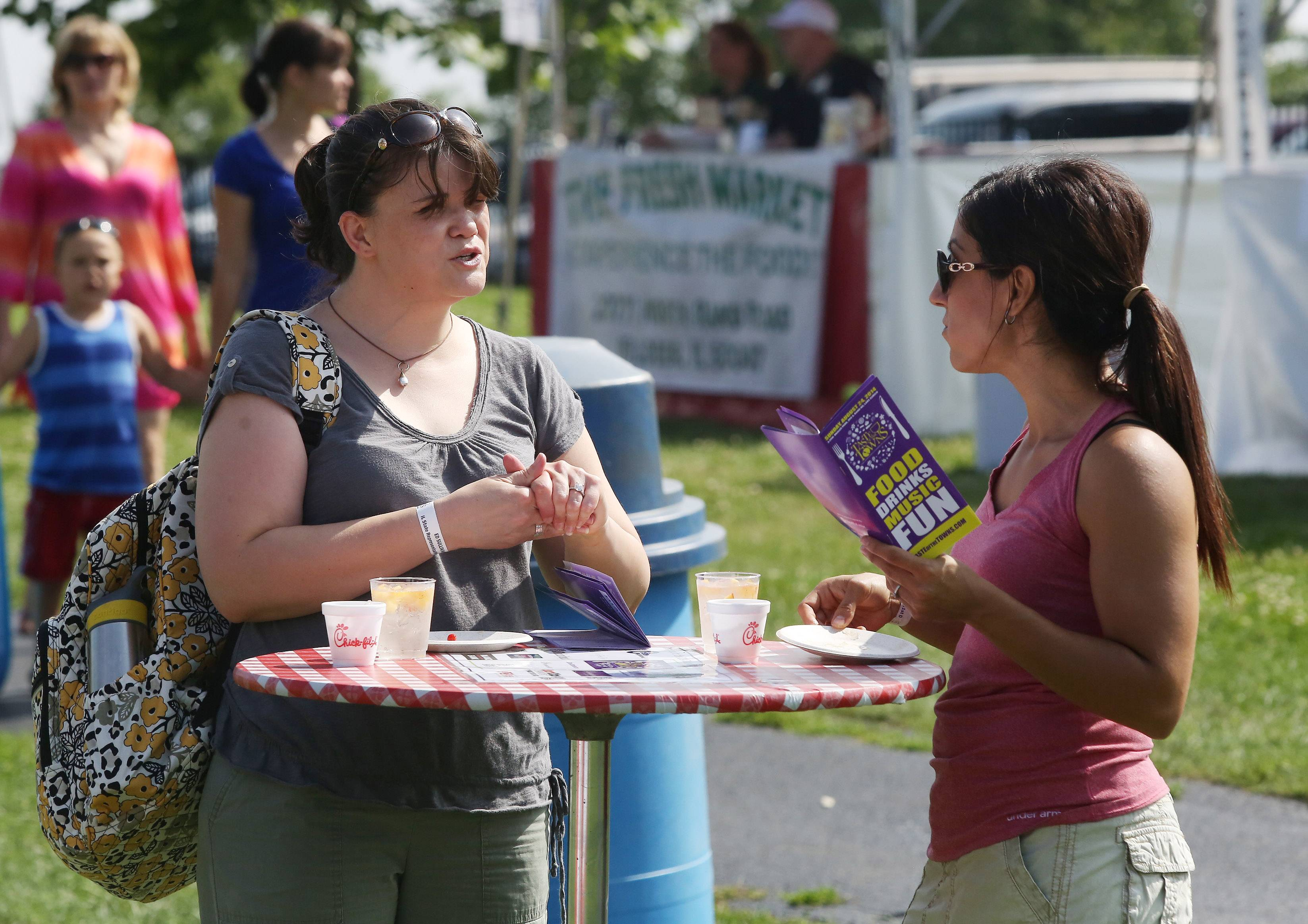 Gloria Beck of Lake Zurich, left, and Nora Wennerstrom of Libertyville sample food and drinks Sunday during the 8th annual Lake Zurich Area Chamber of Commerce Taste of the Towns at Paulus Park.