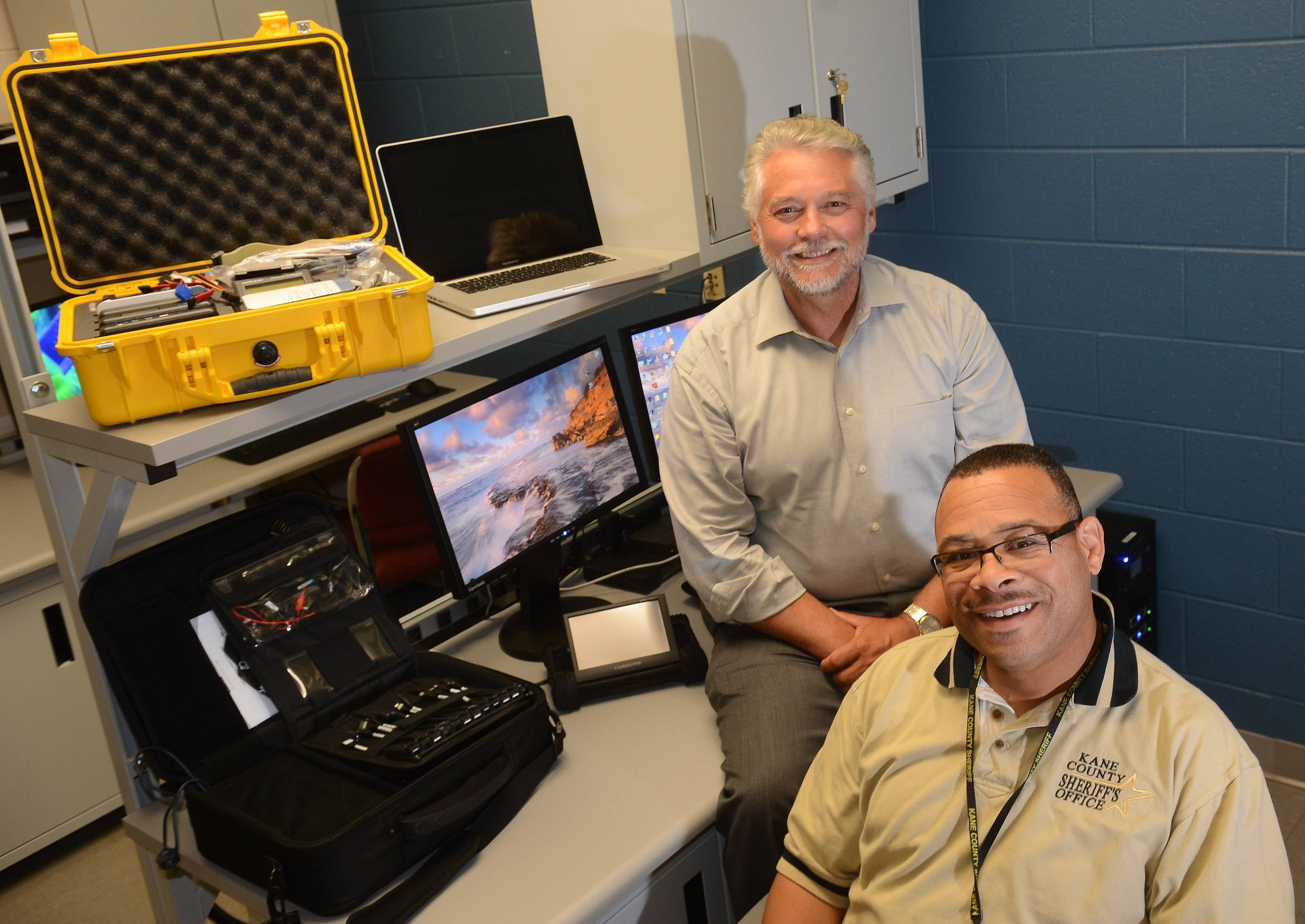 Elgin Community College Associate Dean Scott Adams, left, and Keith Smith, a Kane County sheriff's detective who specializes in cybercrimes and digital forensics, oversee the college's new digital forensics lab.
