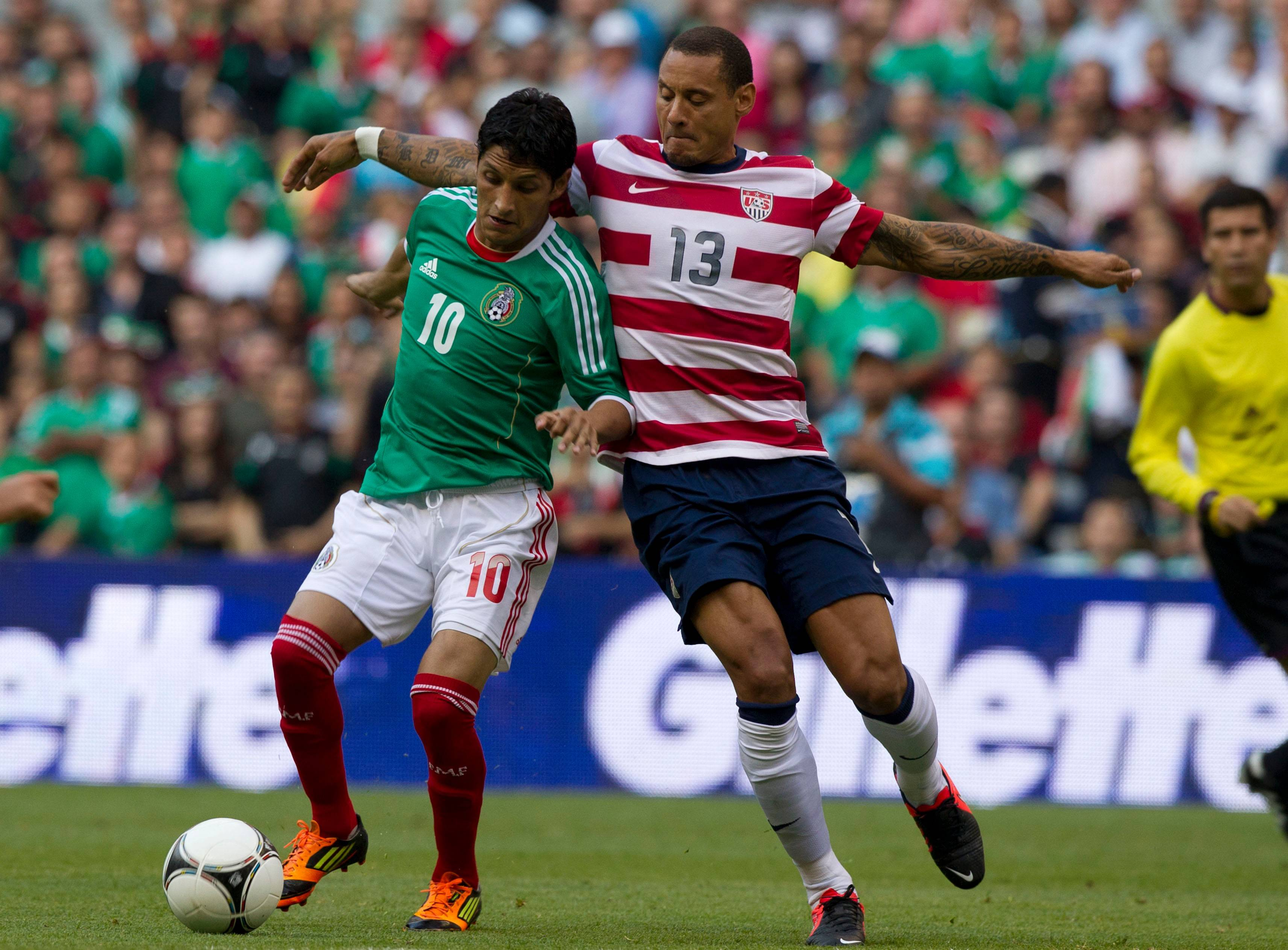 Mexico's Angel Reyna, left, and U.S. Jermaine Jones battle for the ball during a friendly soccer match Aug. 15 in Mexico City.
