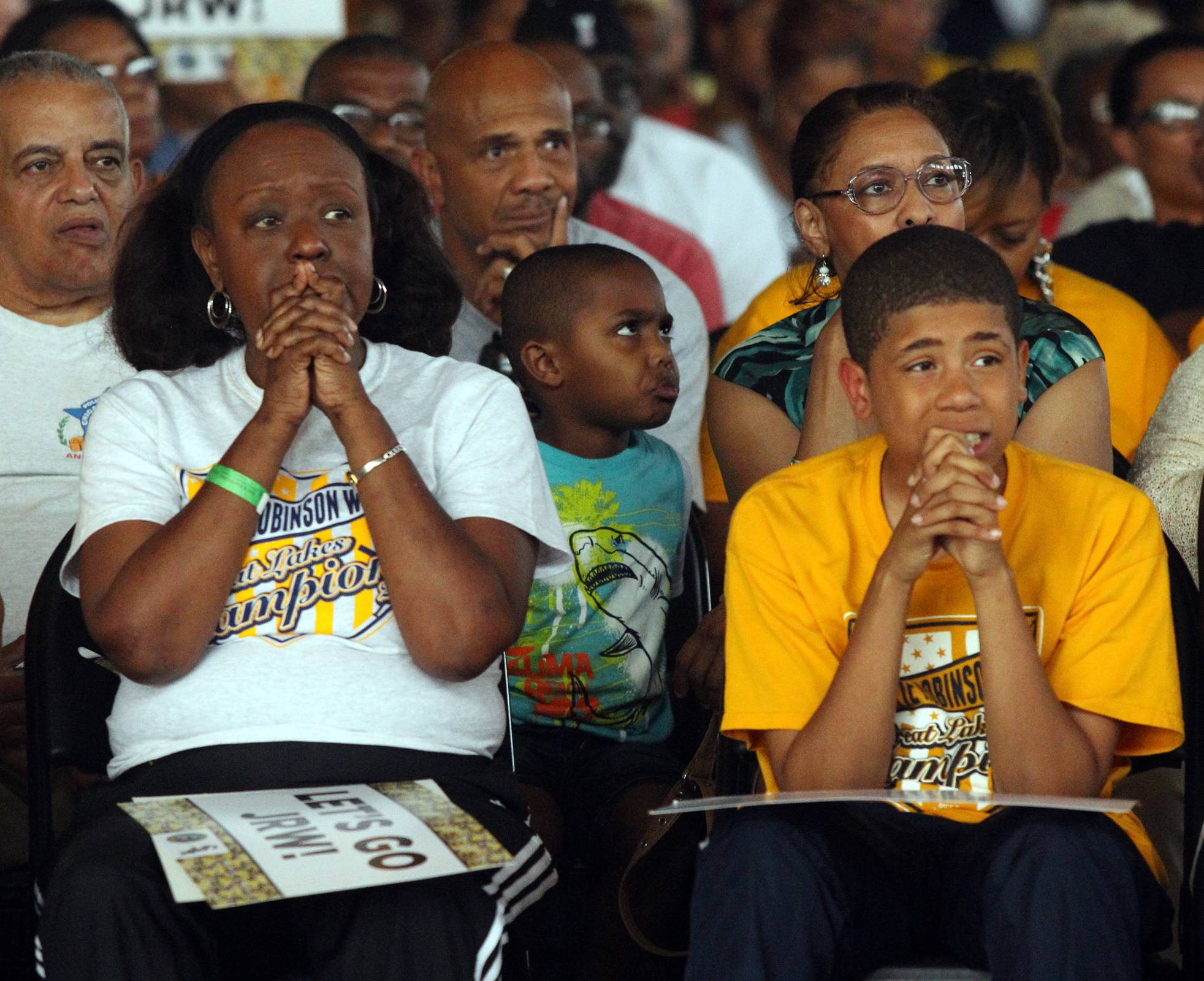 Chicagoans Beverly Harris, left, and Kameron Betton, worry as they watch the Jackie Robinson West team in their last at-bat in the Little League World Series as they watched at the Salvation Army Kroc Community Center in Chicago Sunday. The Jackie Robinson West team lost to South Korea 8-4.