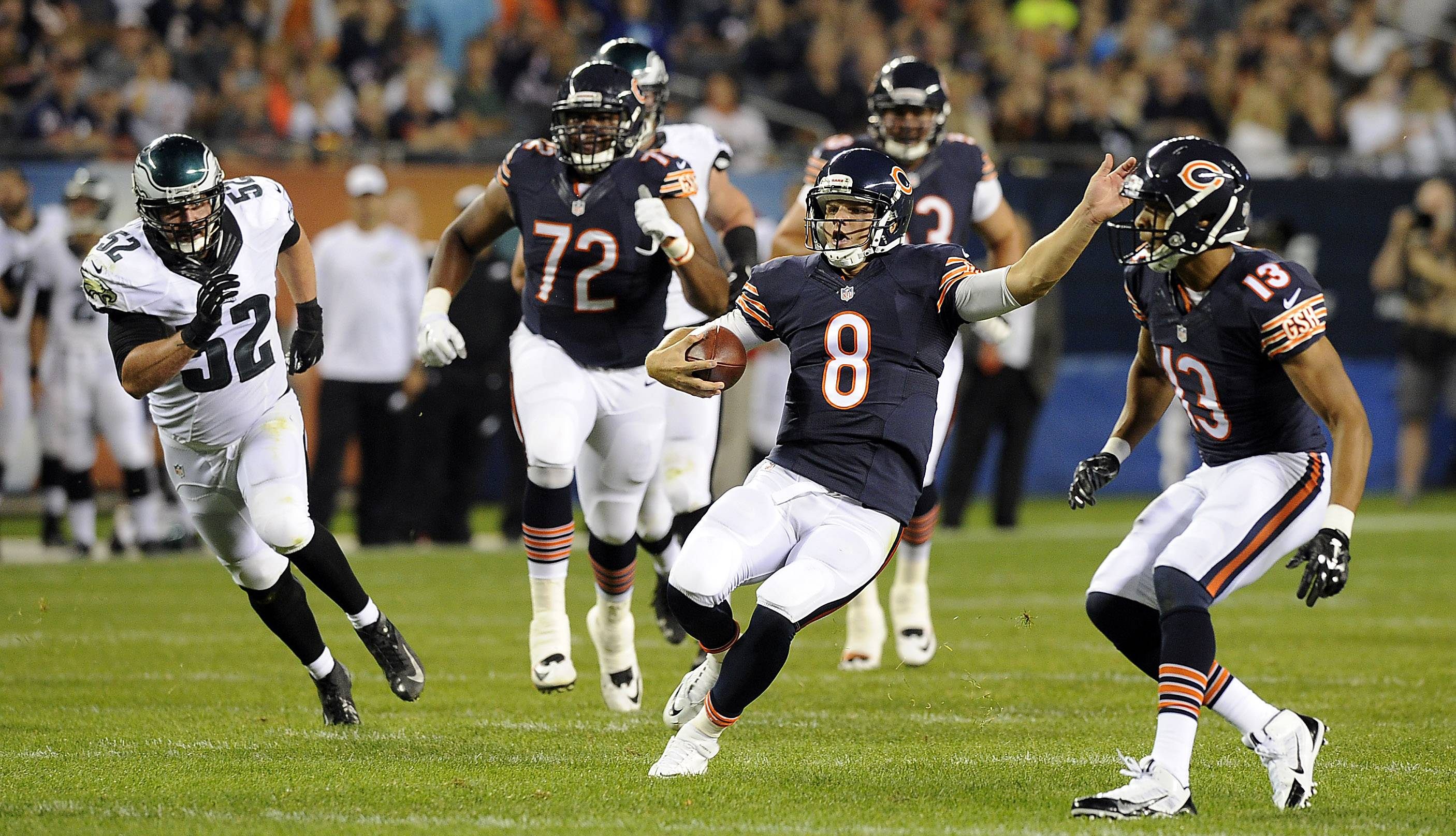 Bears quarterback Jimmy Clausen, scrambling for yardage in the preseason opener, won the backup job because he is considered to have a much greater upside than Jordan Palmer.