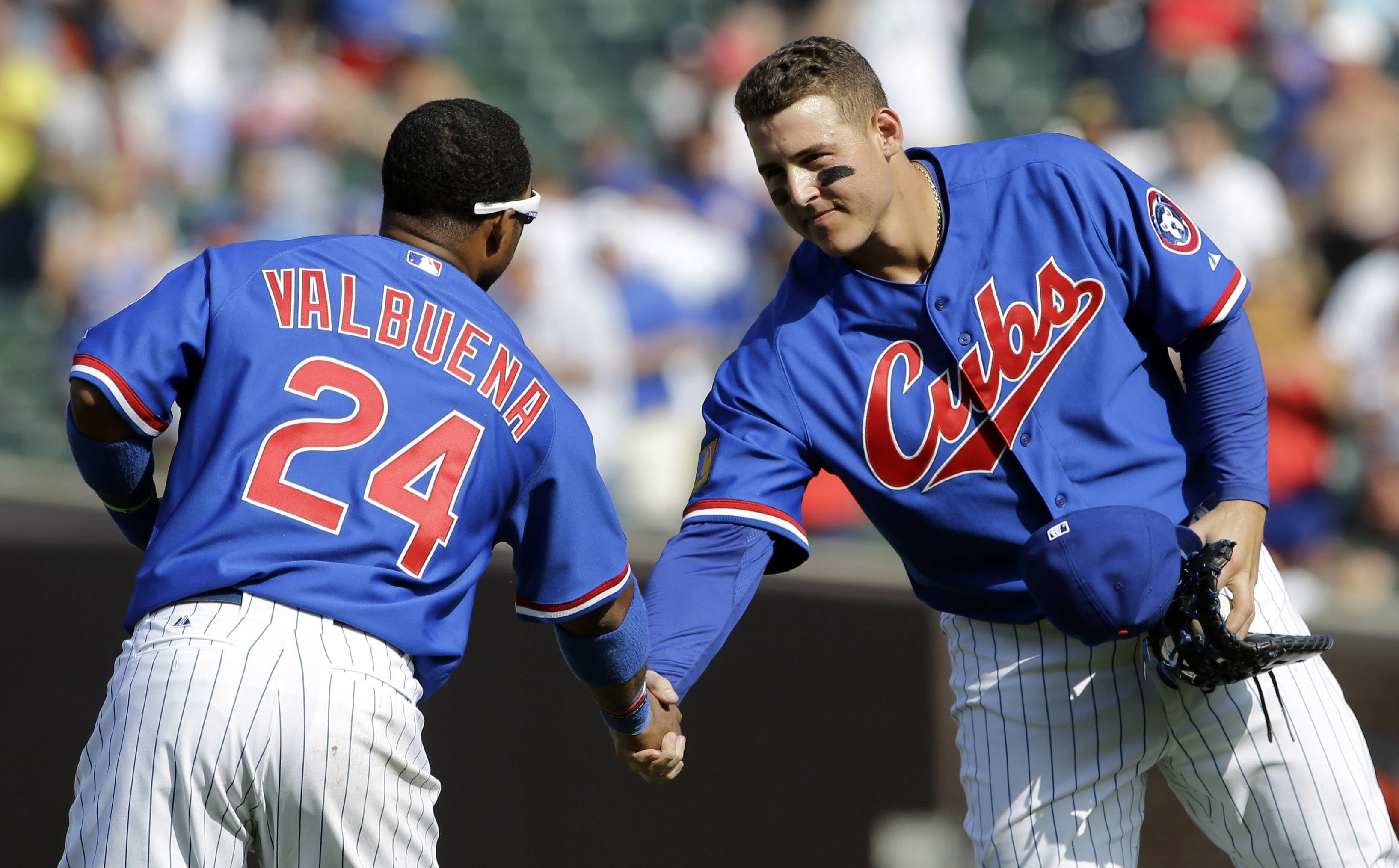 Anthony Rizzo celebrates with teammate Luis Valbuena after the Cubs defeated the first-place Baltimore Orioles 2-1 on Sunday to complete the weekend sweep.