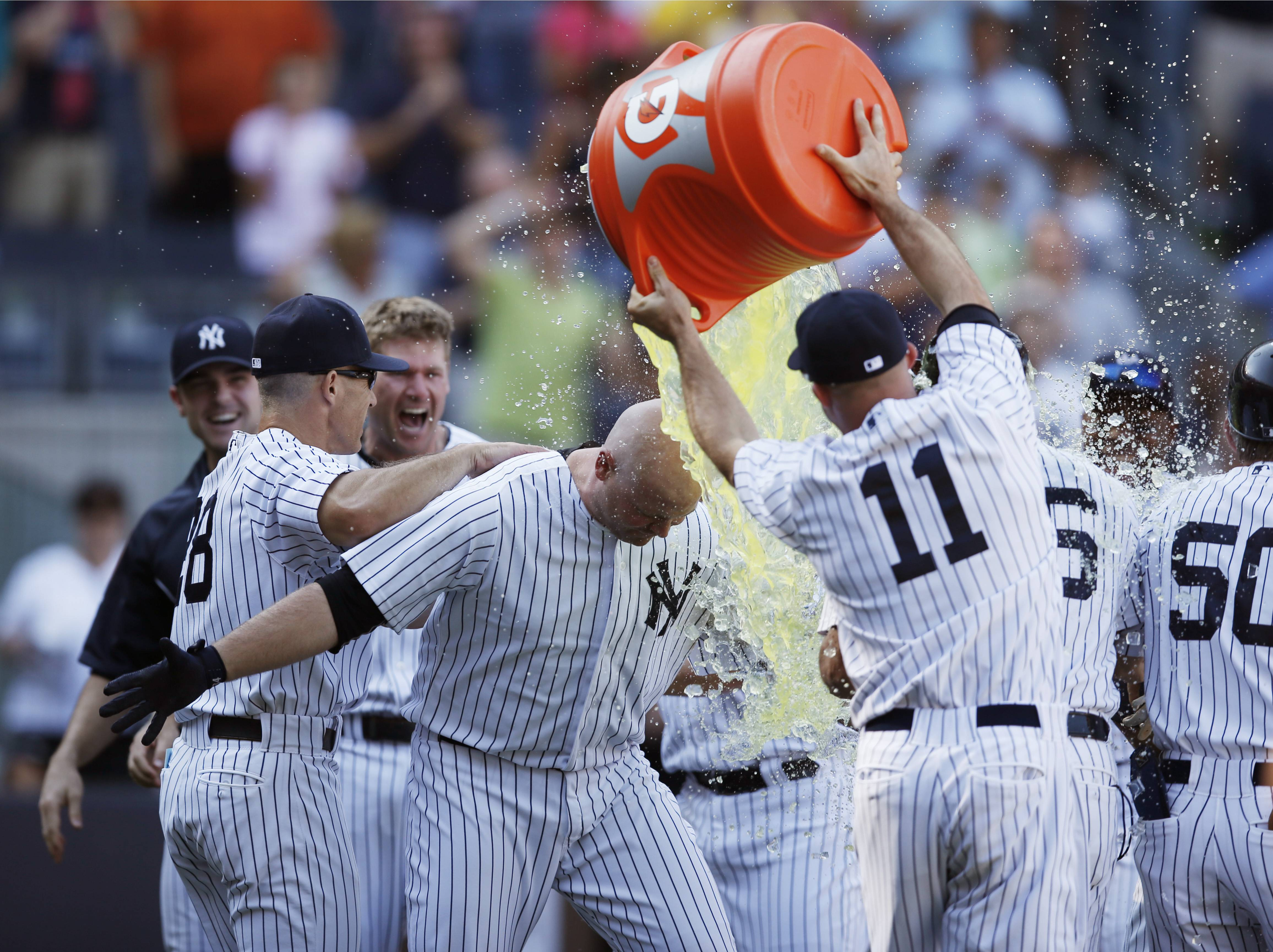 New York Yankees Brett Gardner (11) dumps Gatorade on the Yankees' Brian McCann after McCann hit a pinch-hit, 10th-inning, walk-off, 3-run home run off Chicago White Sox relief pitcher Jake Petricka.