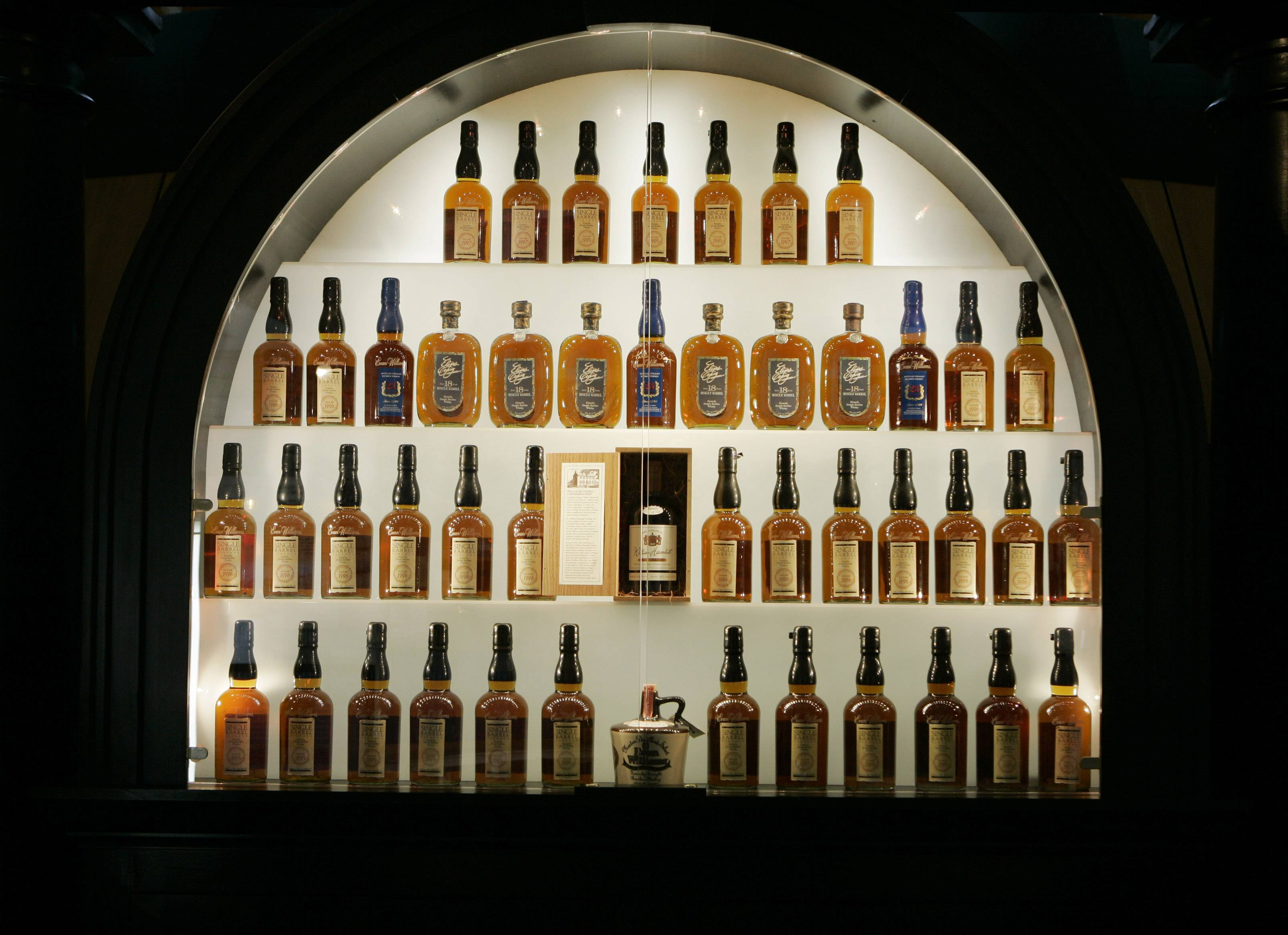 Bottles of bourbon are on display in a case at the Heaven Hill Bourbon Heritage Center in Bardstown, Ky. Kentucky bourbon makers have stashed away their largest stockpiles in more than a generation due to resurgent demand for the venerable brown spirit.